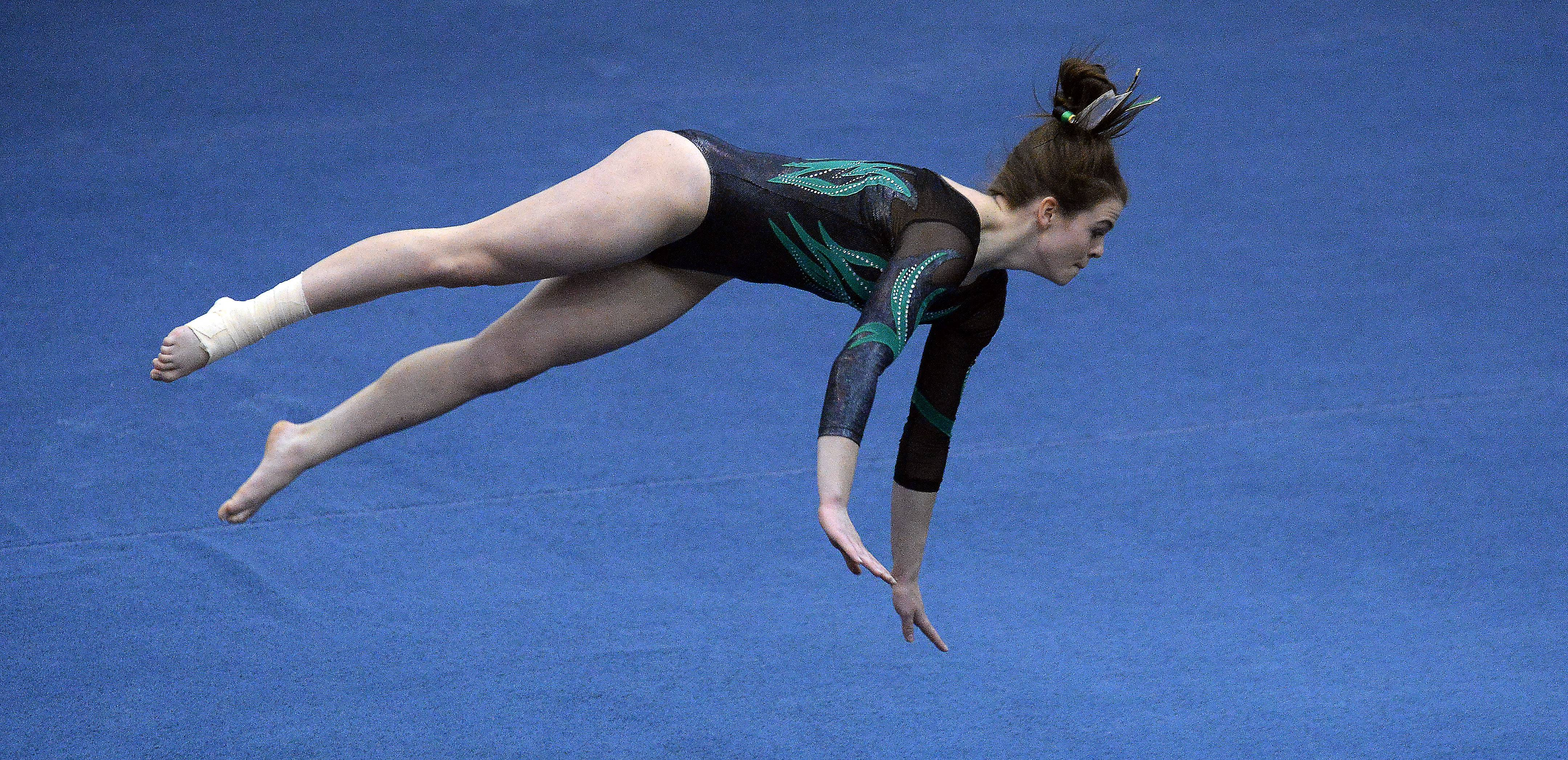 Fremd's Christine Jensen of Fremd works the floor exercise in the girls gymnastics state meet in Palatine on Friday.