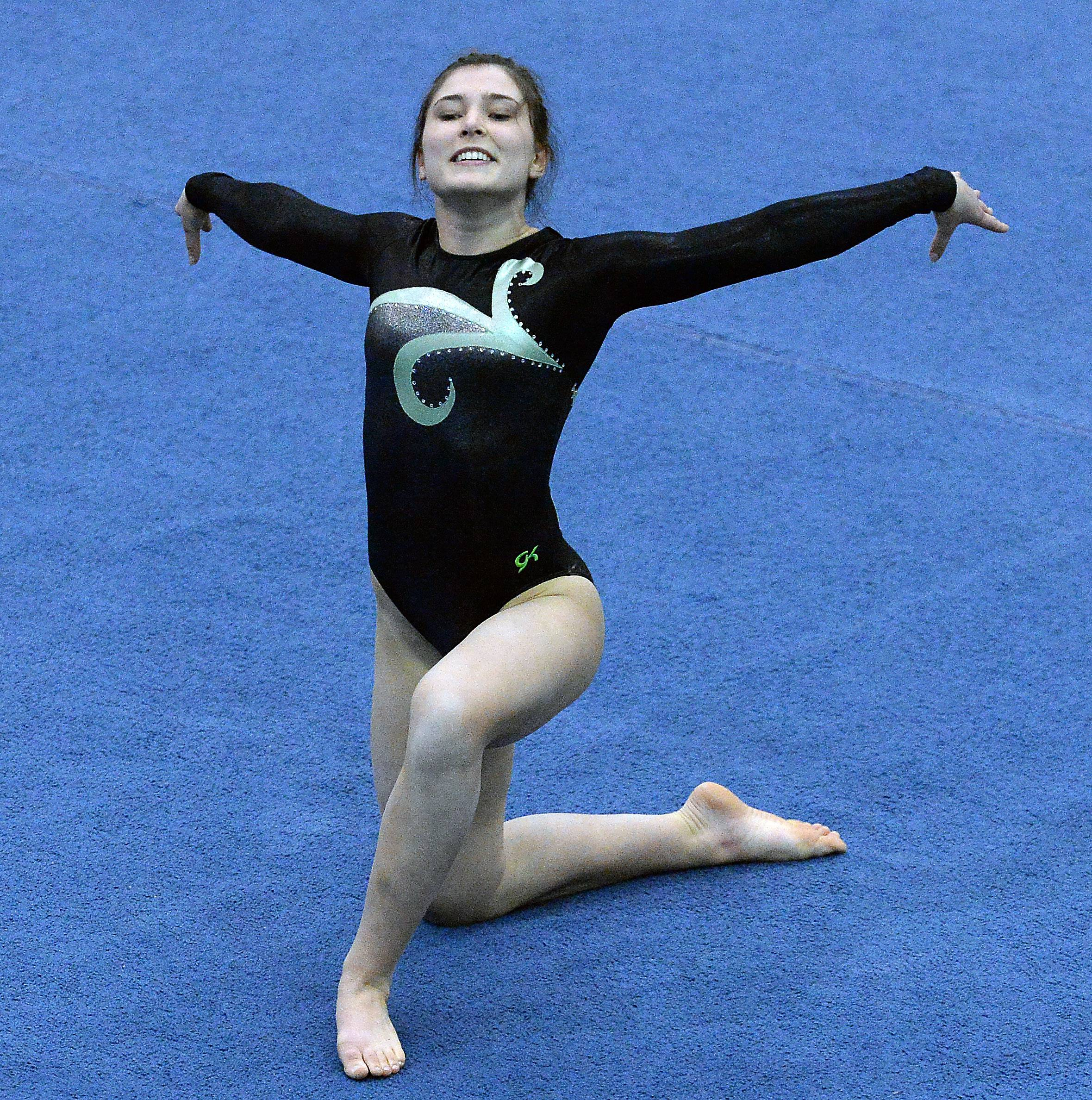 Elk Grove's Amelia Rafferty work floor exercise in the girls gymnastics state meet in Palatine on Friday.