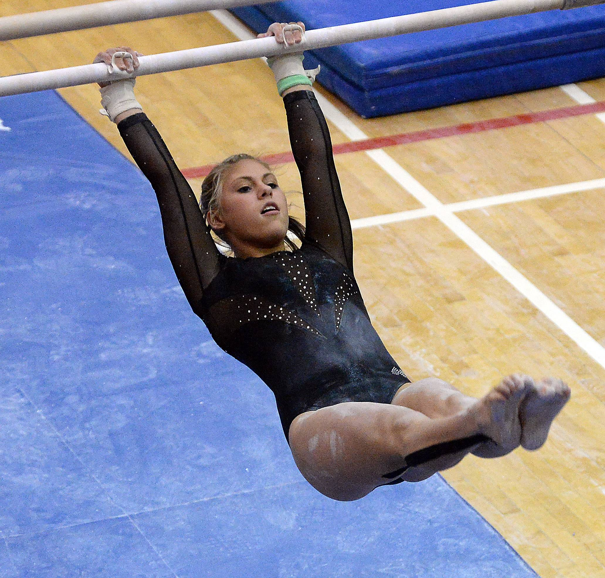 Rachel Dugan of St. Charles Co-op performs on the uneven parallel bars Friday.