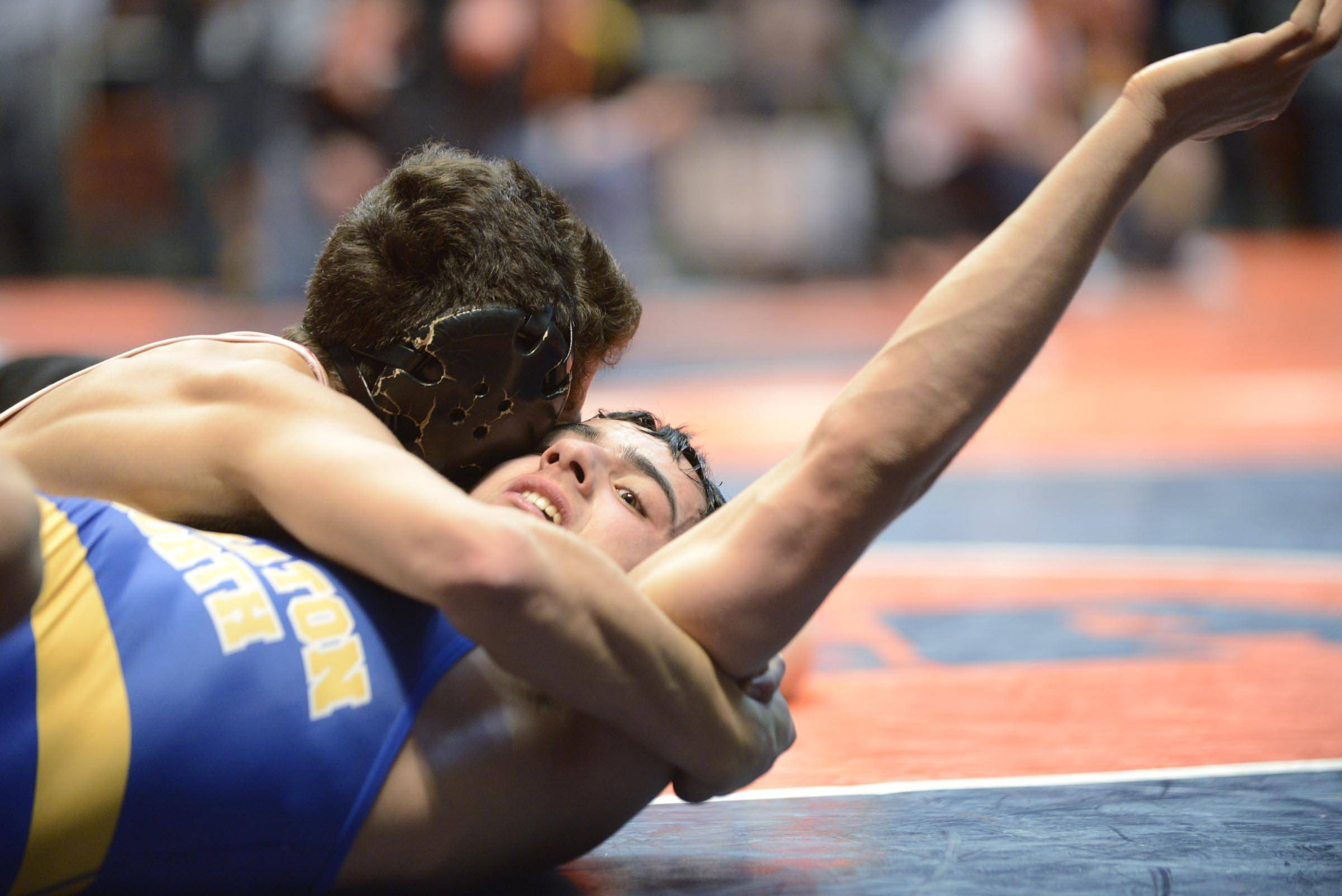 John Starks/jstarks@dailyherald.comJohnny Jimenez of Marmion Academy pins Dylan Thurston of Wheaton North Friday in the 126-pound weight class semifinals of the wrestling IHSA Class 3A state tournament at State Farm Center in Champaign.