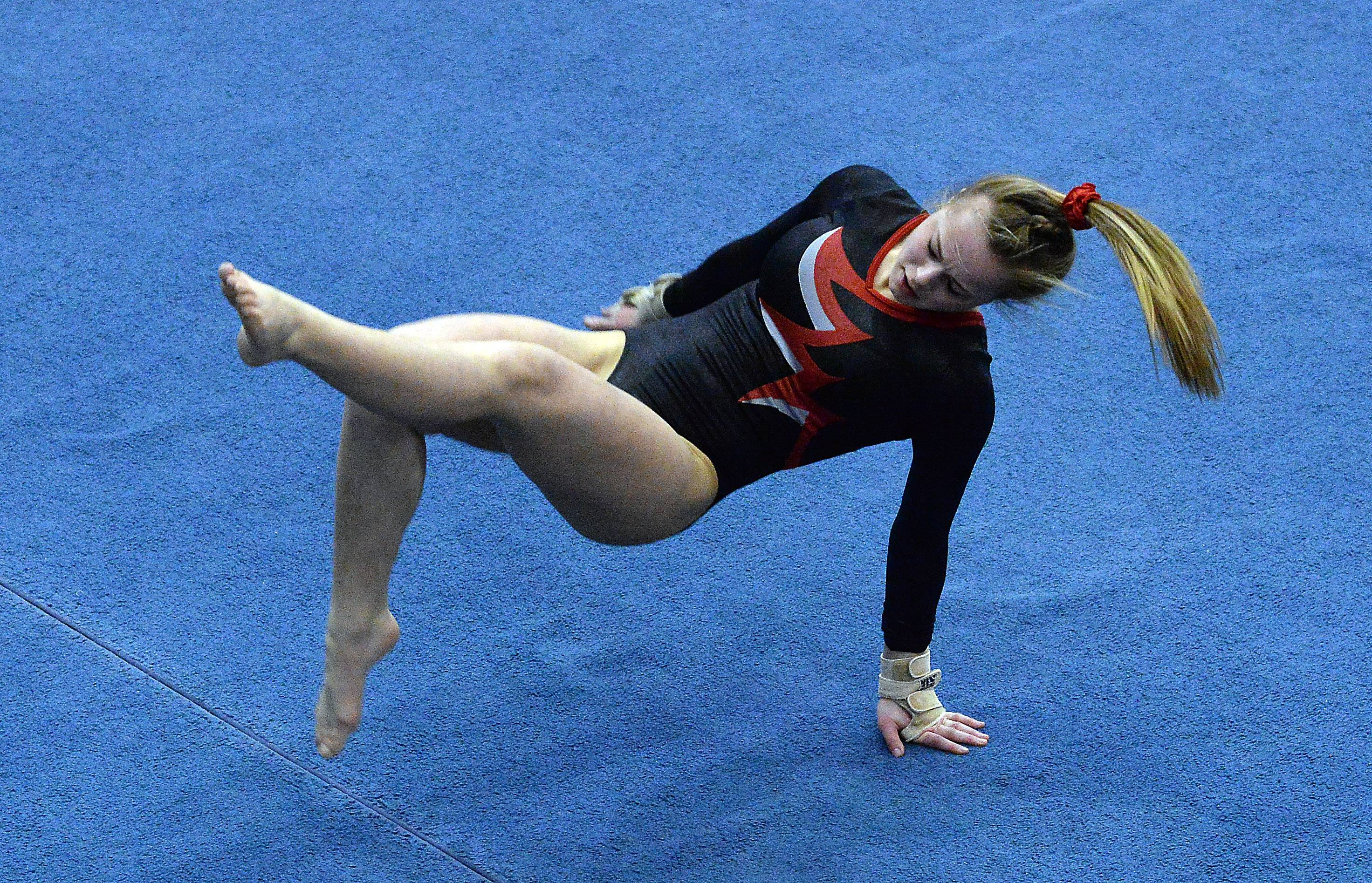 McKenzie Kehr of Mundelein on the floor exercise in the girls gymnastics state finals in Palatine on Friday.