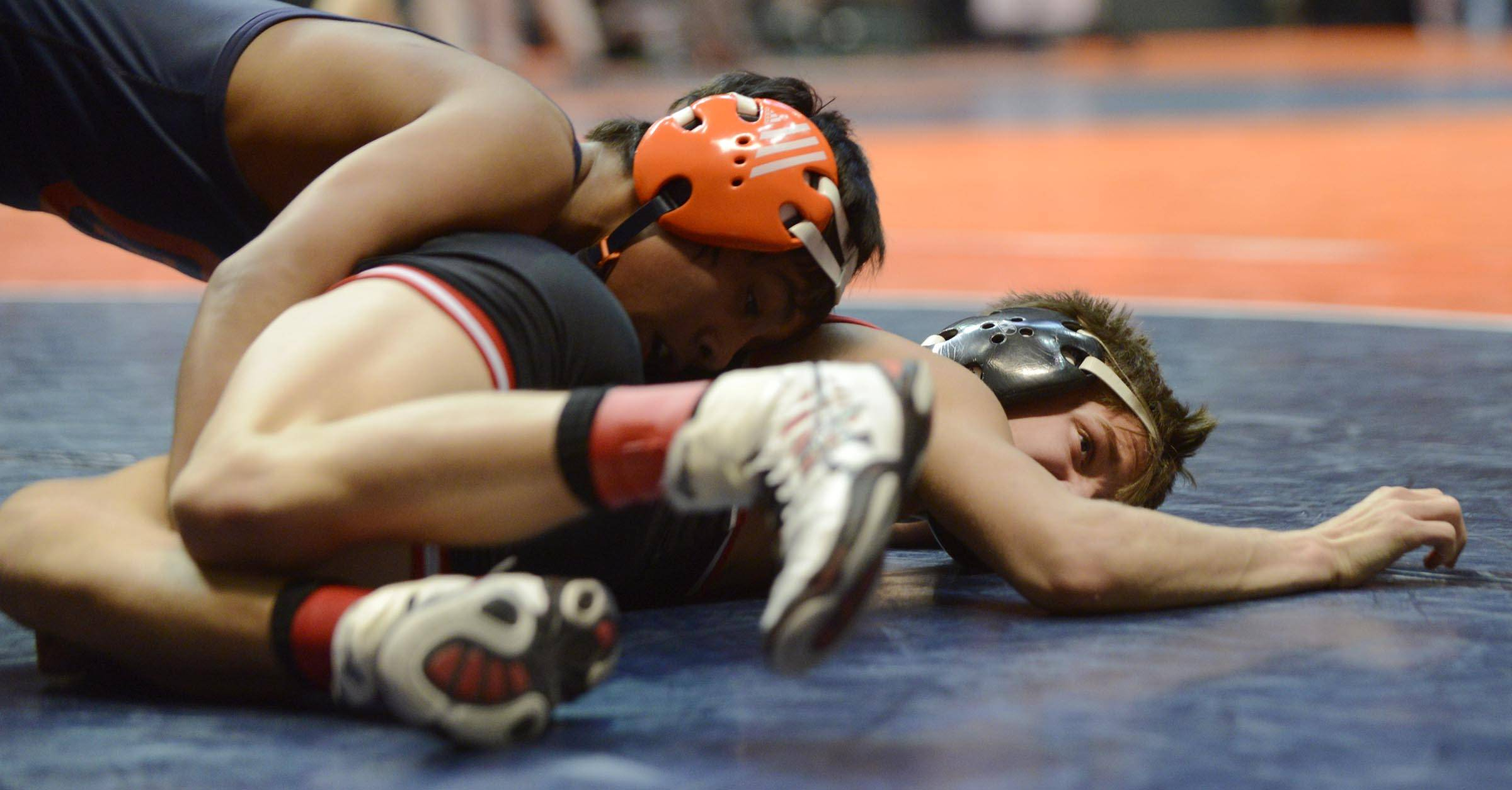Mitch Stathakis of Barrington High School competes Friday against Jason Renteria of Oak Park River Forest in the 106-pound weight class semifinals of the wrestling IHSA Class 3A state tournament at State Farm Center in Champaign.