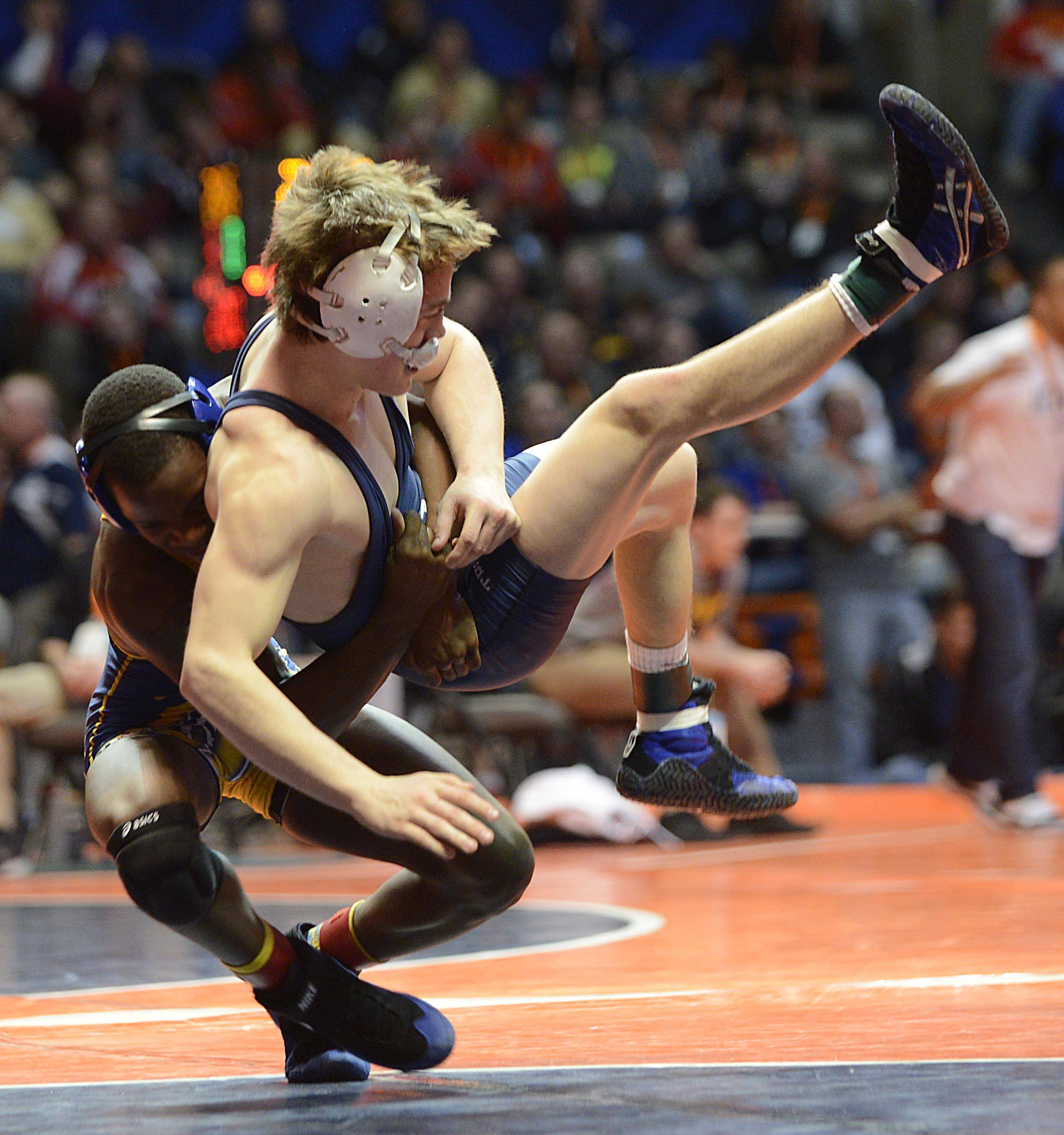 Michael Cullen of Cary-Grove High School is thrown by Kris Williams of Thornwood High School Friday in the 120-pound weight class semifinals of the wrestling IHSA Class 3A state tournament at State Farm Center in Champaign.