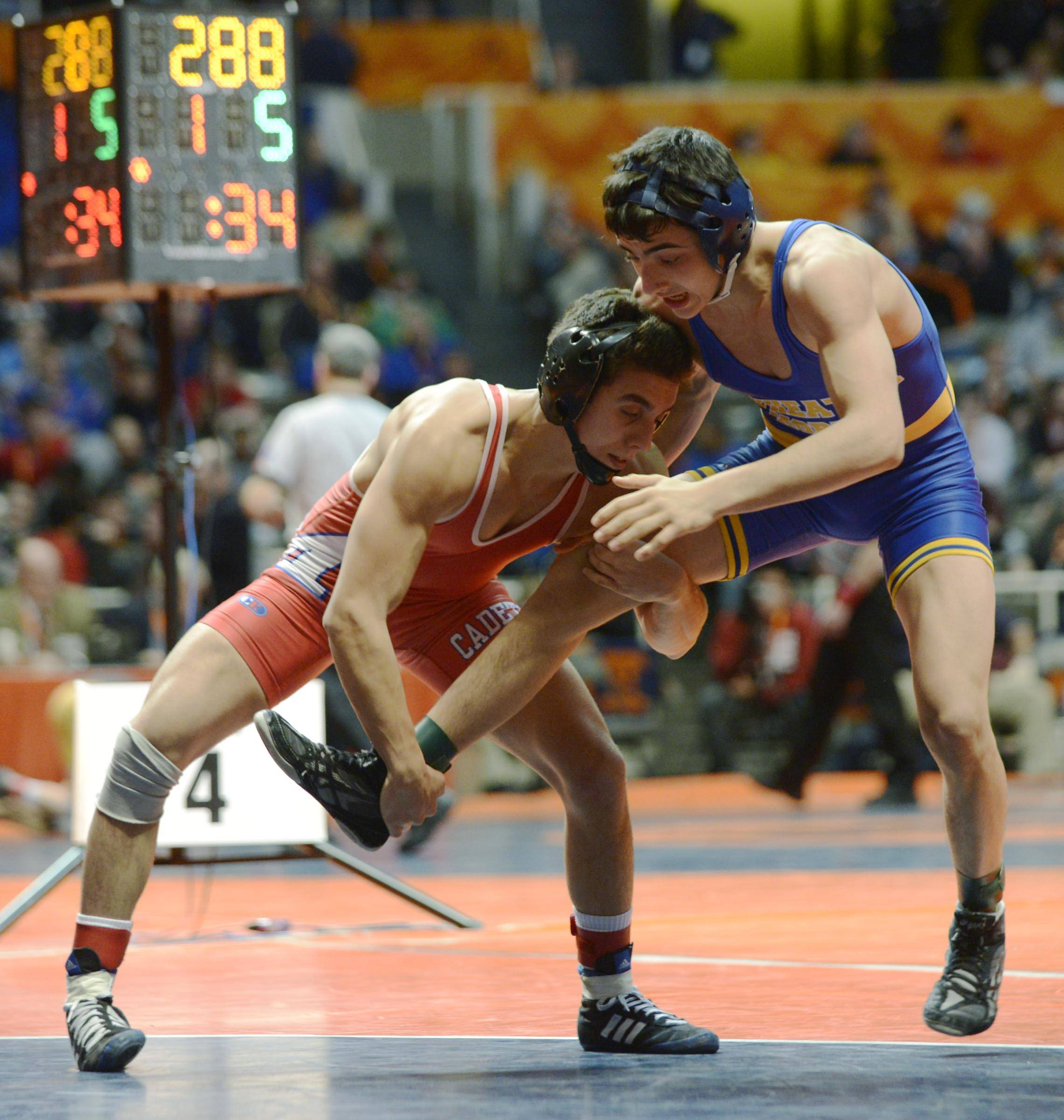 Johnny Jimenez of Marmion Academy, left, competes against Dylan Thurston of Wheaton North Friday in the 126-pound weight class semifinals of the wrestling IHSA Class 3A state tournament at State Farm Center in Champaign.