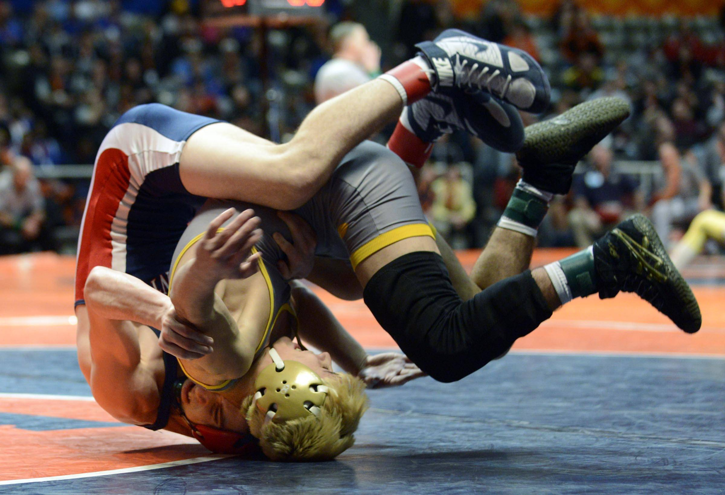 Bobby Alexander of Conant High School competes against Jered Cortez of Glenbard North High School Friday in the 132-pound weight class semifinals of the wrestling IHSA Class 3A state tournament at State Farm Center in Champaign.