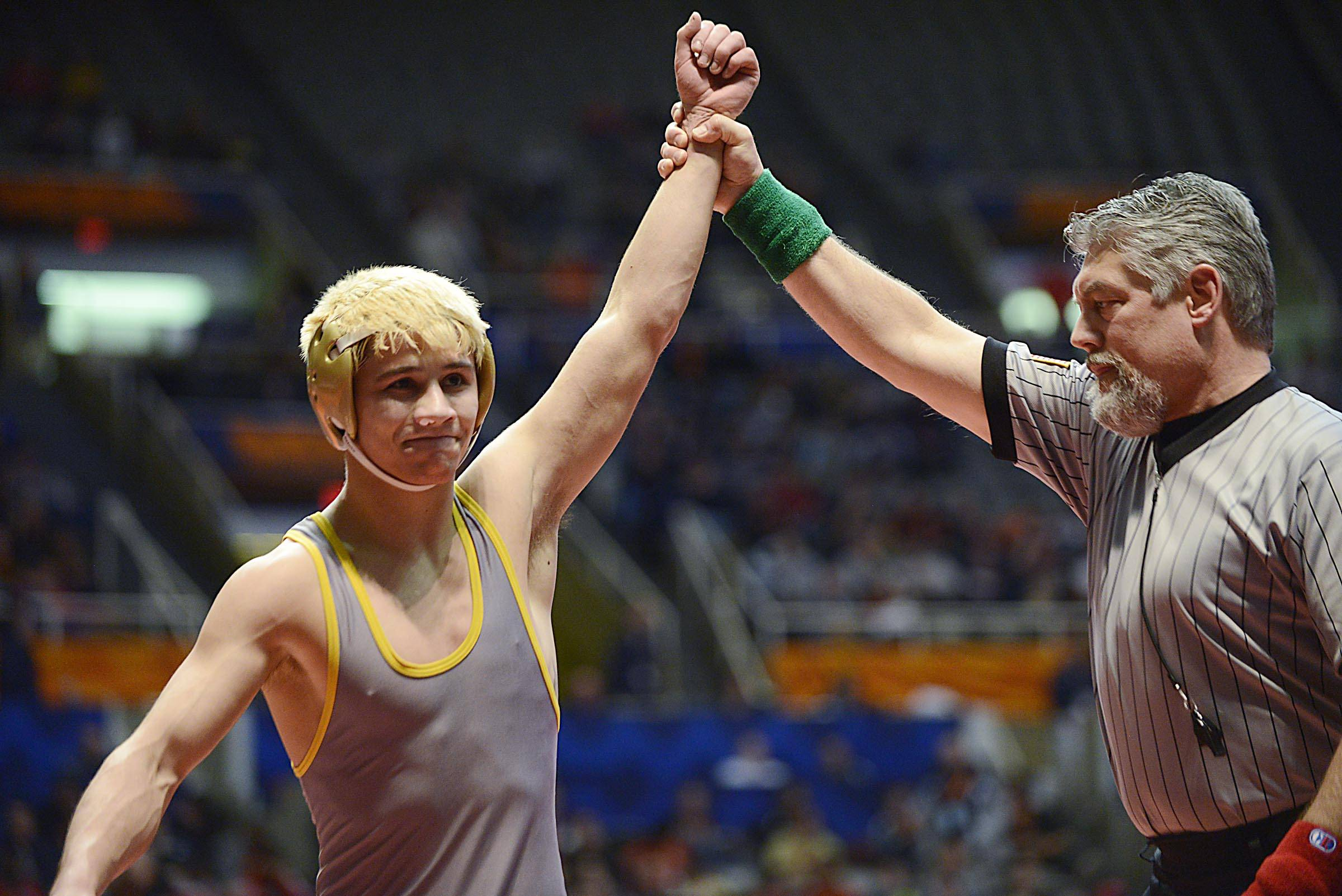 Jared Cortez of Glenbard North High School is declared the winner Friday in the 132-pound weight class semifinals of the wrestling IHSA Class 3A state tournament at State Farm Center in Champaign.