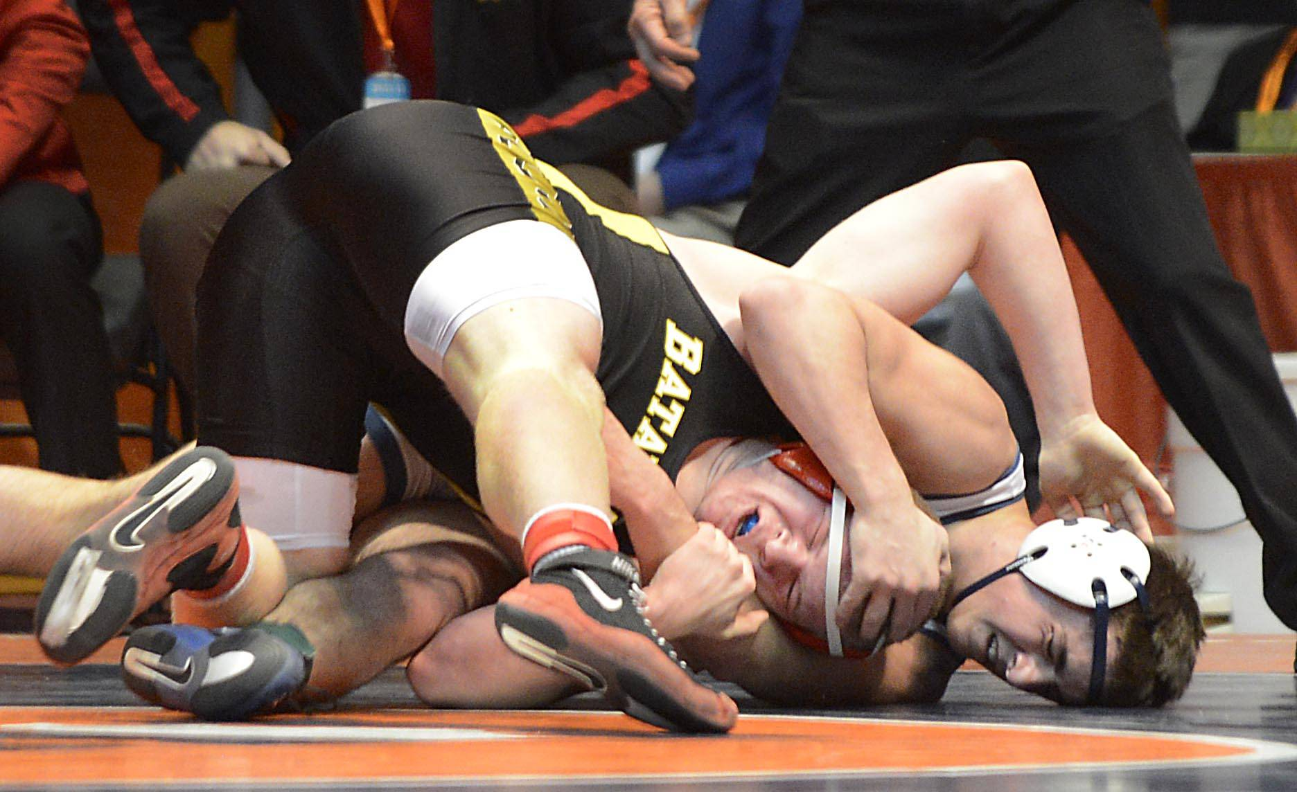 Lake Park's Nico Daniello grabs the head of Batavia's Connor McKeehan Friday in quarterfinals of the 220-pound weight class of the 3A IHSA state tournament .