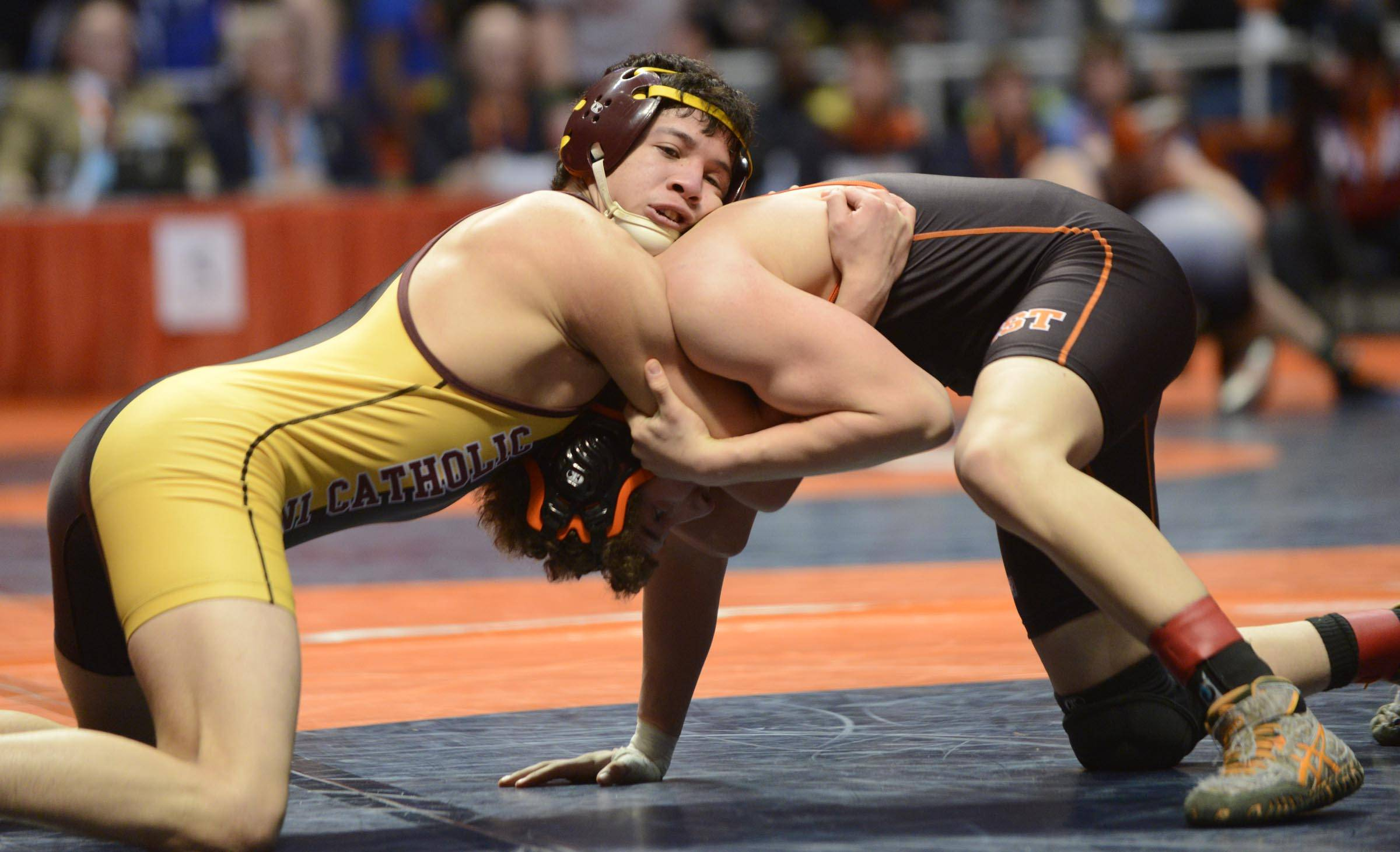 Chris Garcia of Montini High School competes against Kyle Rodriguez of Lincolnway West High School Friday in the 145-pound weight class semifinals of the wrestling IHSA Class 2A state tournament at State Farm Center in Champaign.