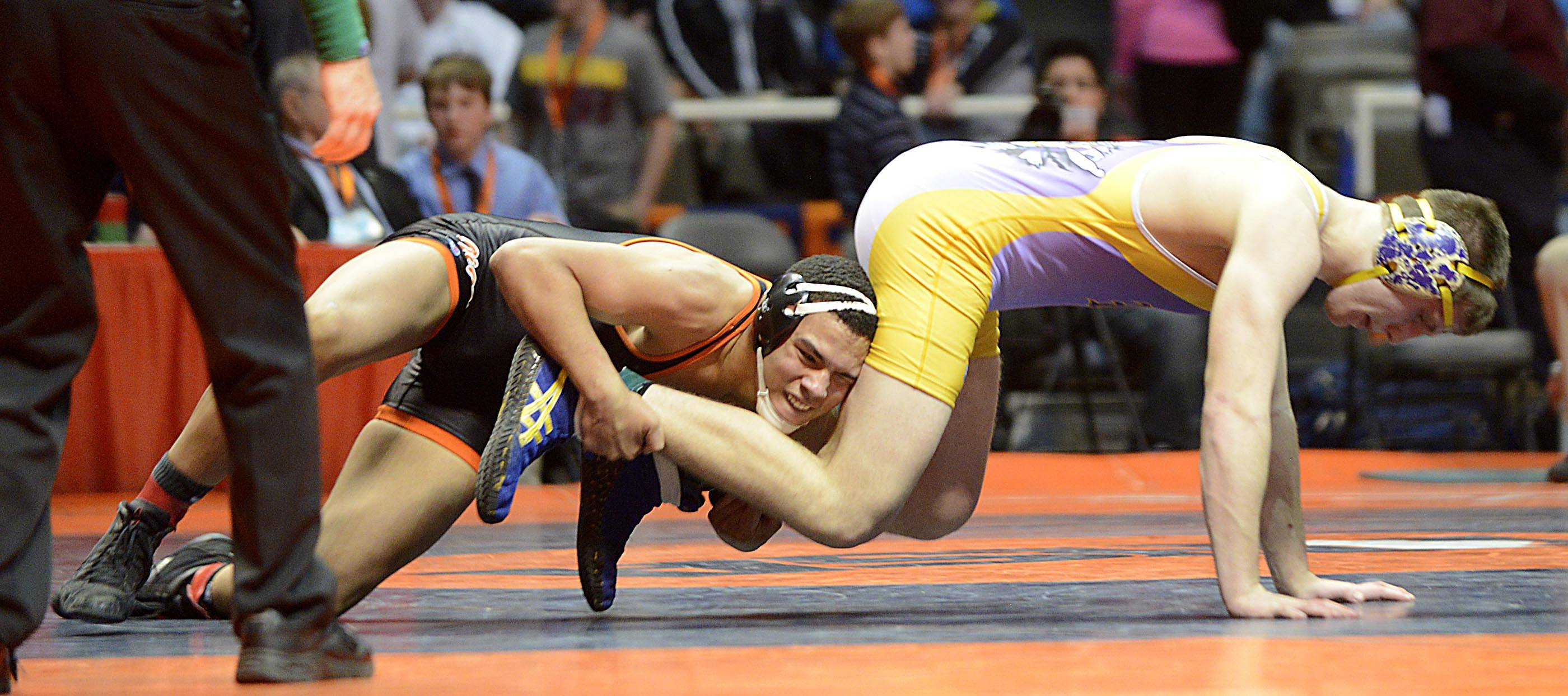 Nate Magiera of Wauconda High School, right, competes against Romeo McKnight of Crystal Lake Central High School Friday in the 220-pound weight class semifinals of the wrestling IHSA Class 2A state tournament at State Farm Center in Champaign.