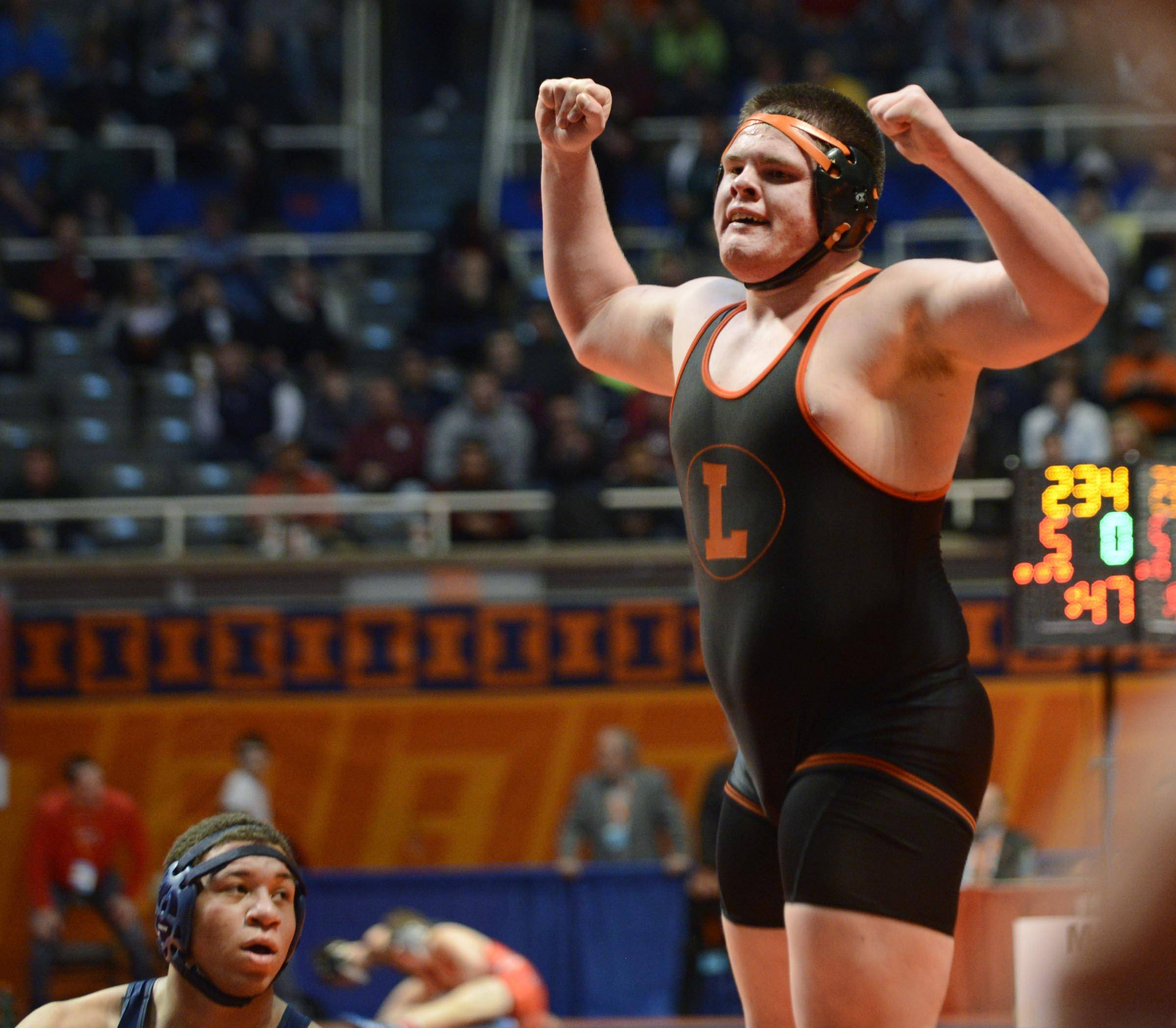 Libertyville's Chris McDermand raises his fists in victory after beating Michael Hobbs of Downers Grove South Friday in quarterfinals of the 285-pound weight class of the 3A IHSA state tournament .