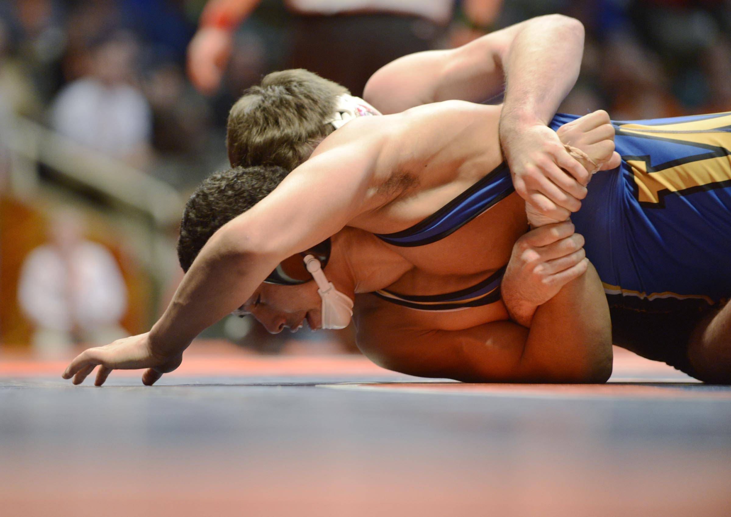 Emery Parker of Warren High School tries to escape Peter Andreotti of Marist High School Friday in the 160-pound weight class semifinals of the wrestling IHSA Class 3A state tournament at State Farm Center in Champaign.
