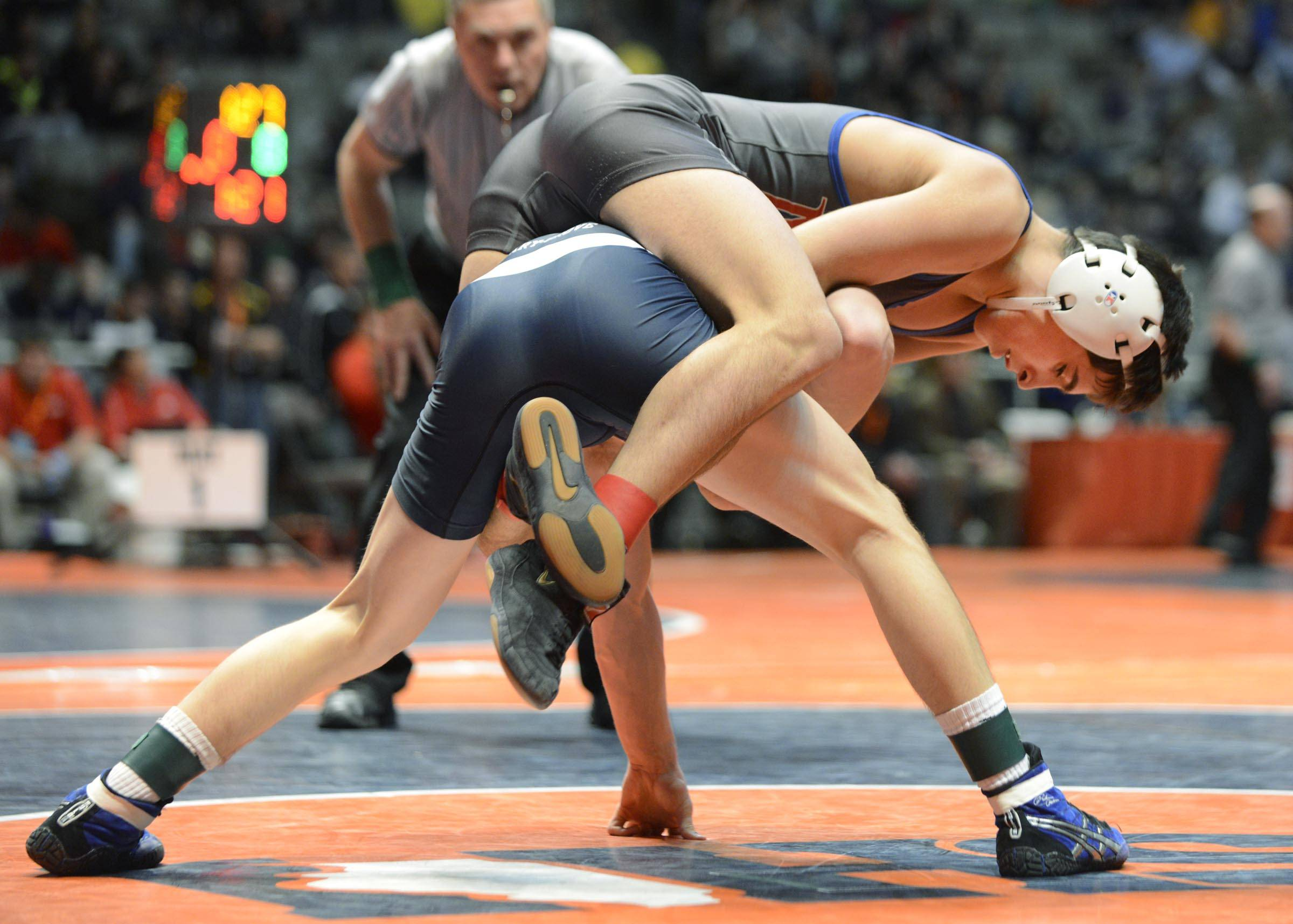 Marmion Acadey's AJ Jaffe rides Cary-Grove's Michael Cullen Friday in quarterfinals of the 120-pound weight class of the 3A IHSA state tournament. Cullen won.