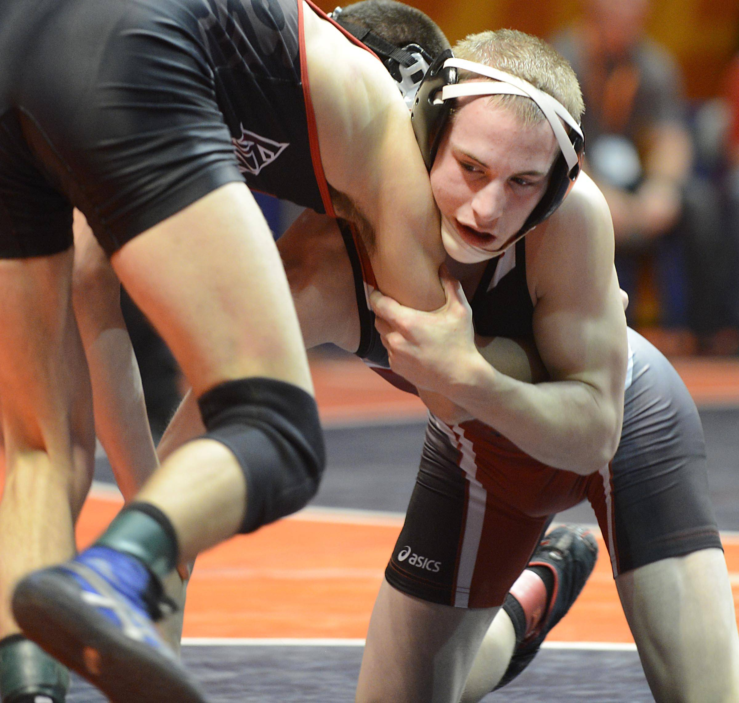 Barrington's Matthew Conrad looks for an opportunity against Joey Nelson of Lincolnway Central Friday in quarterfinals of the 132-pound weight class of the 3A IHSA state tournament .