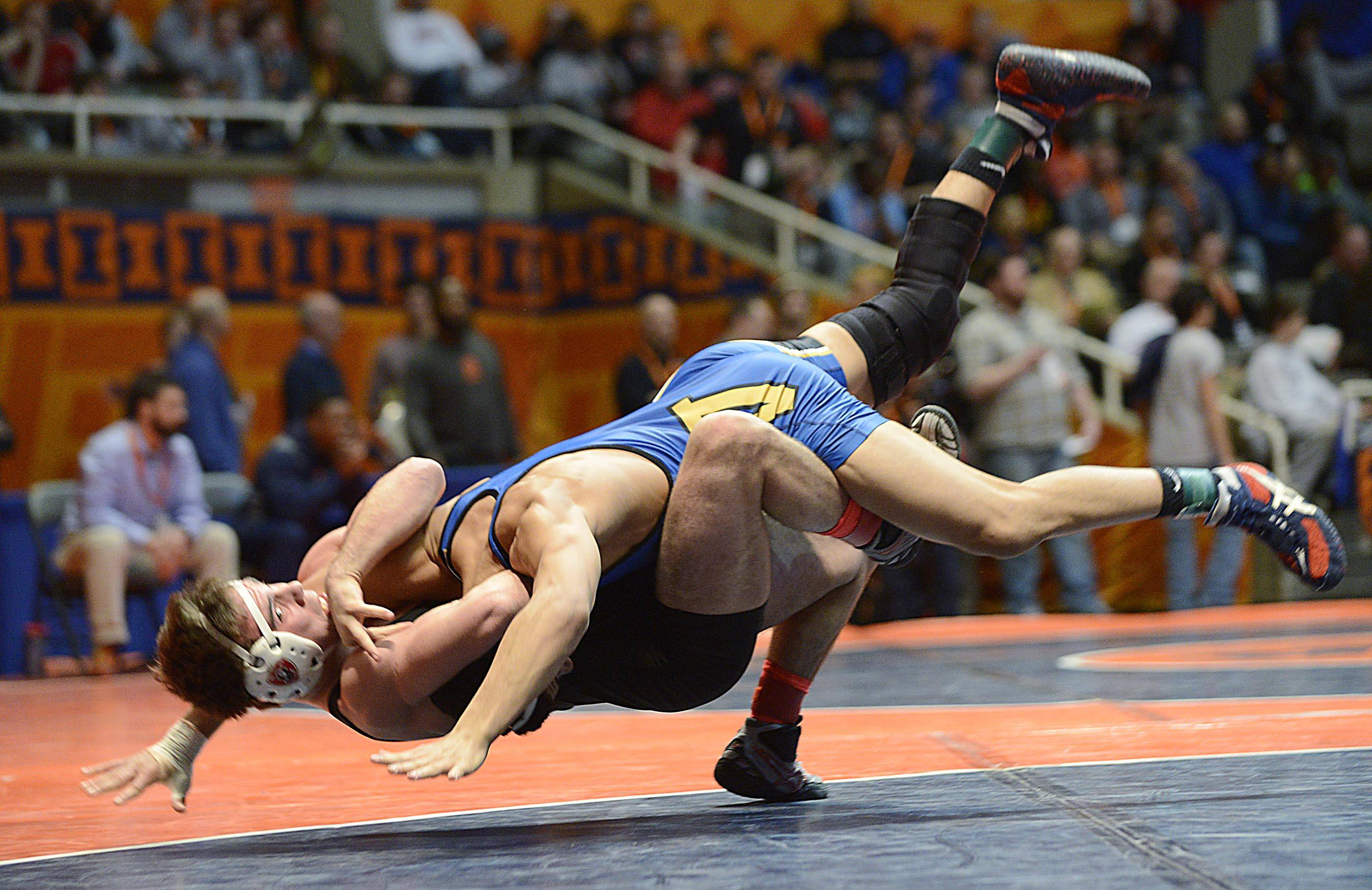 Emery Parker of Warren drives Peter Andreotti of Marist in their 160-pound semifinals.