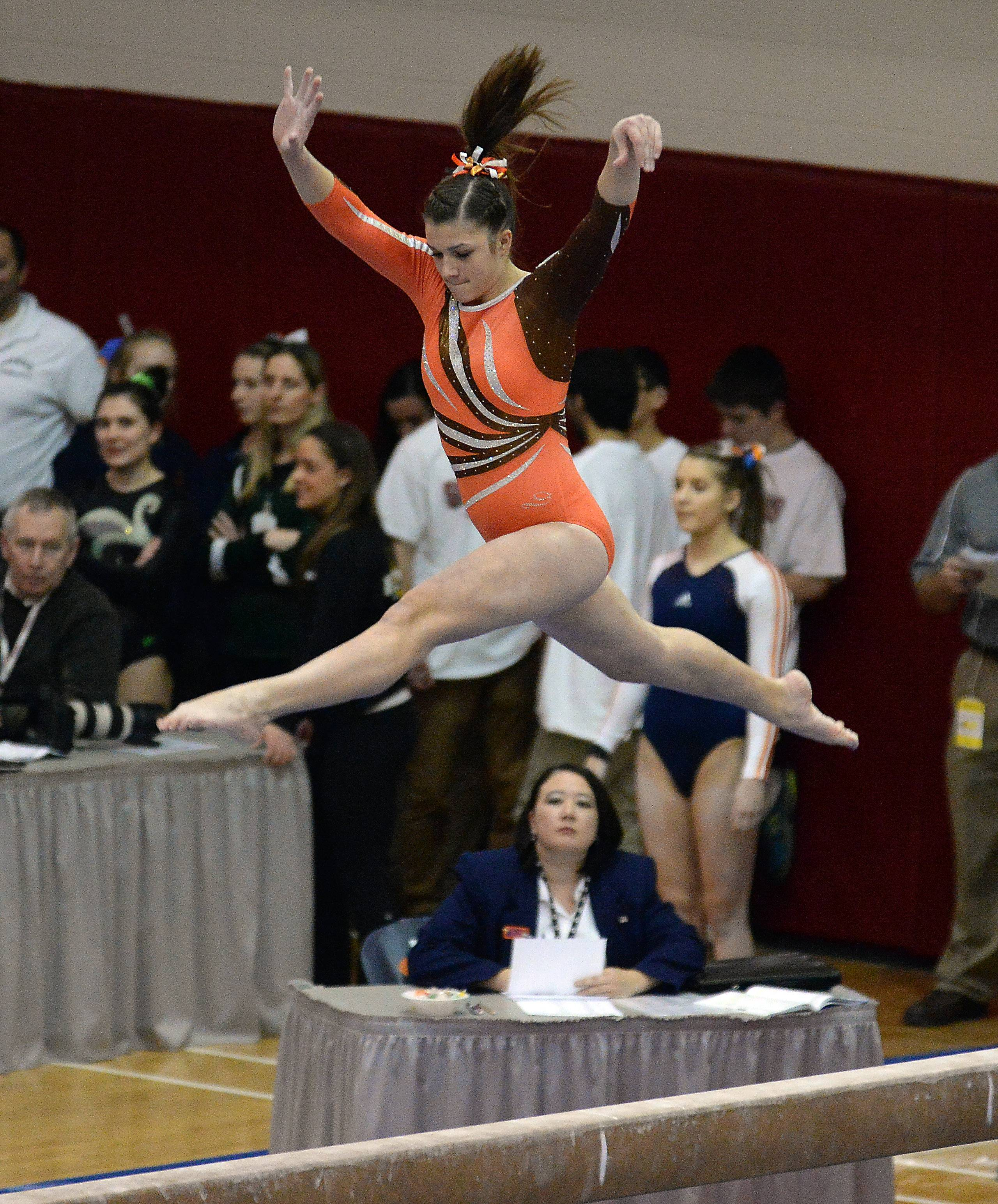 Audrey Channon of Wheaton Warrenville South performs on the beam.