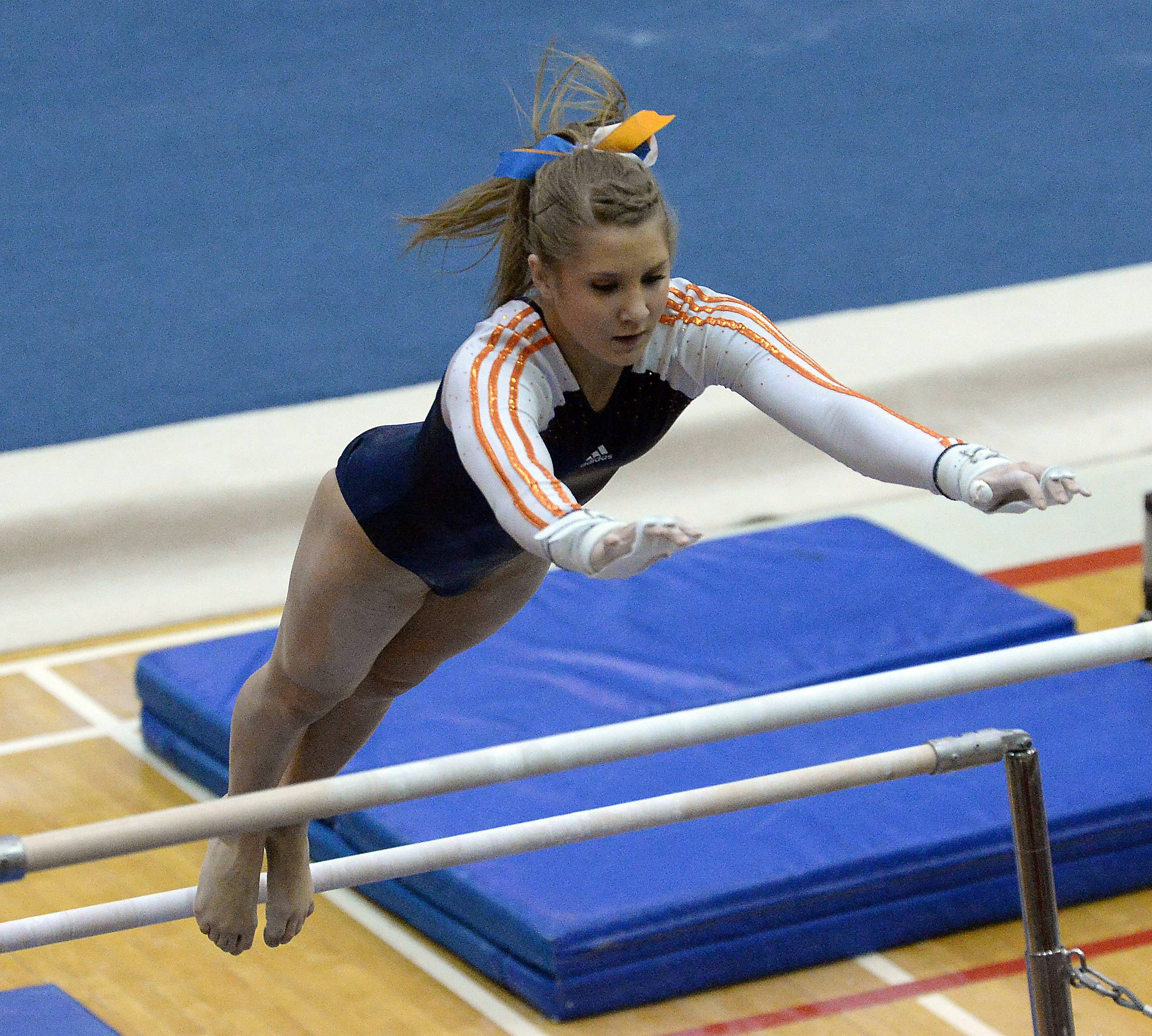Michaela Robert of Naperville North performs on the uneven parallel bars.