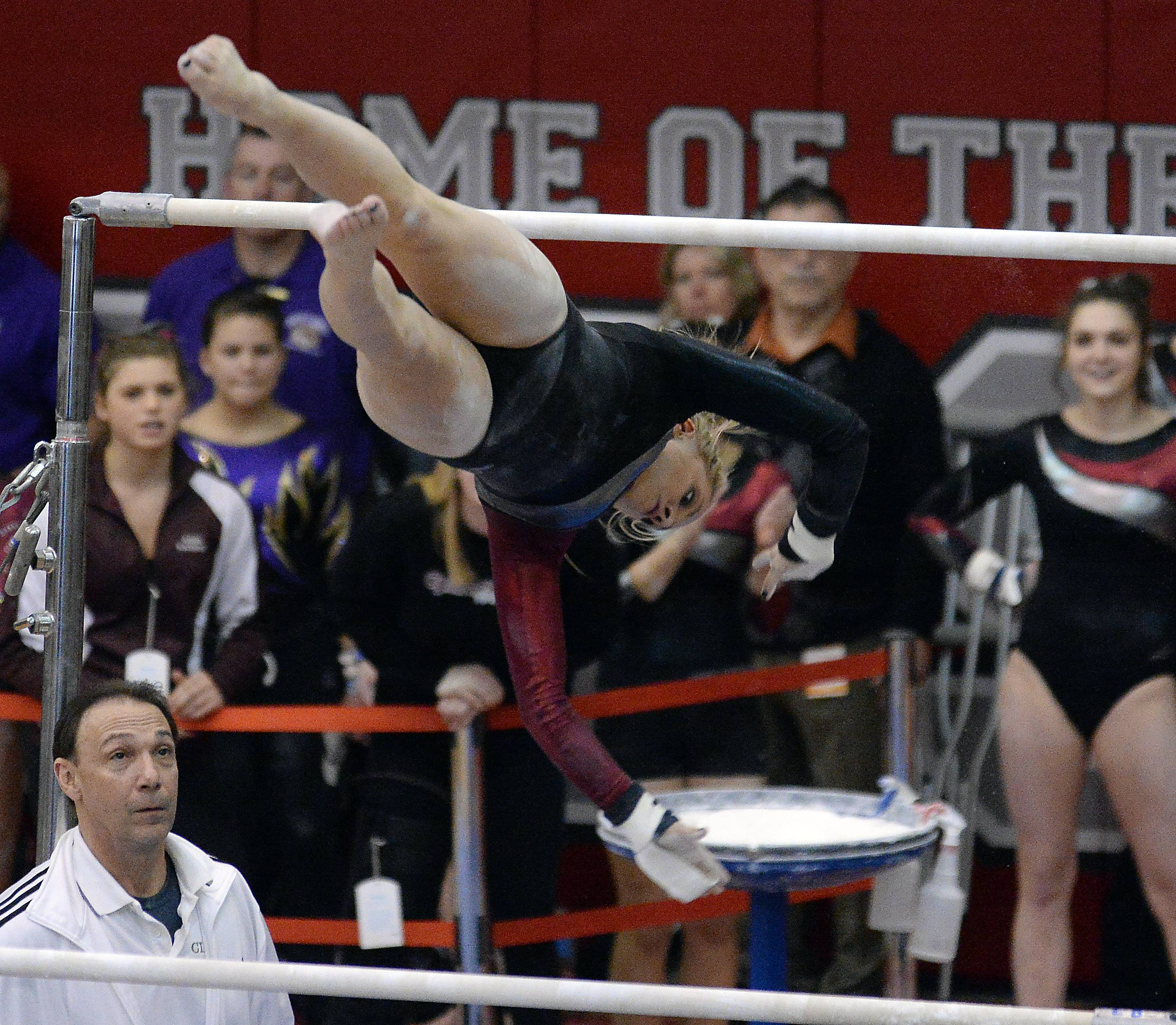 Maddie Solka of Prairie Ridge High School performs on the uneven parallel bars.