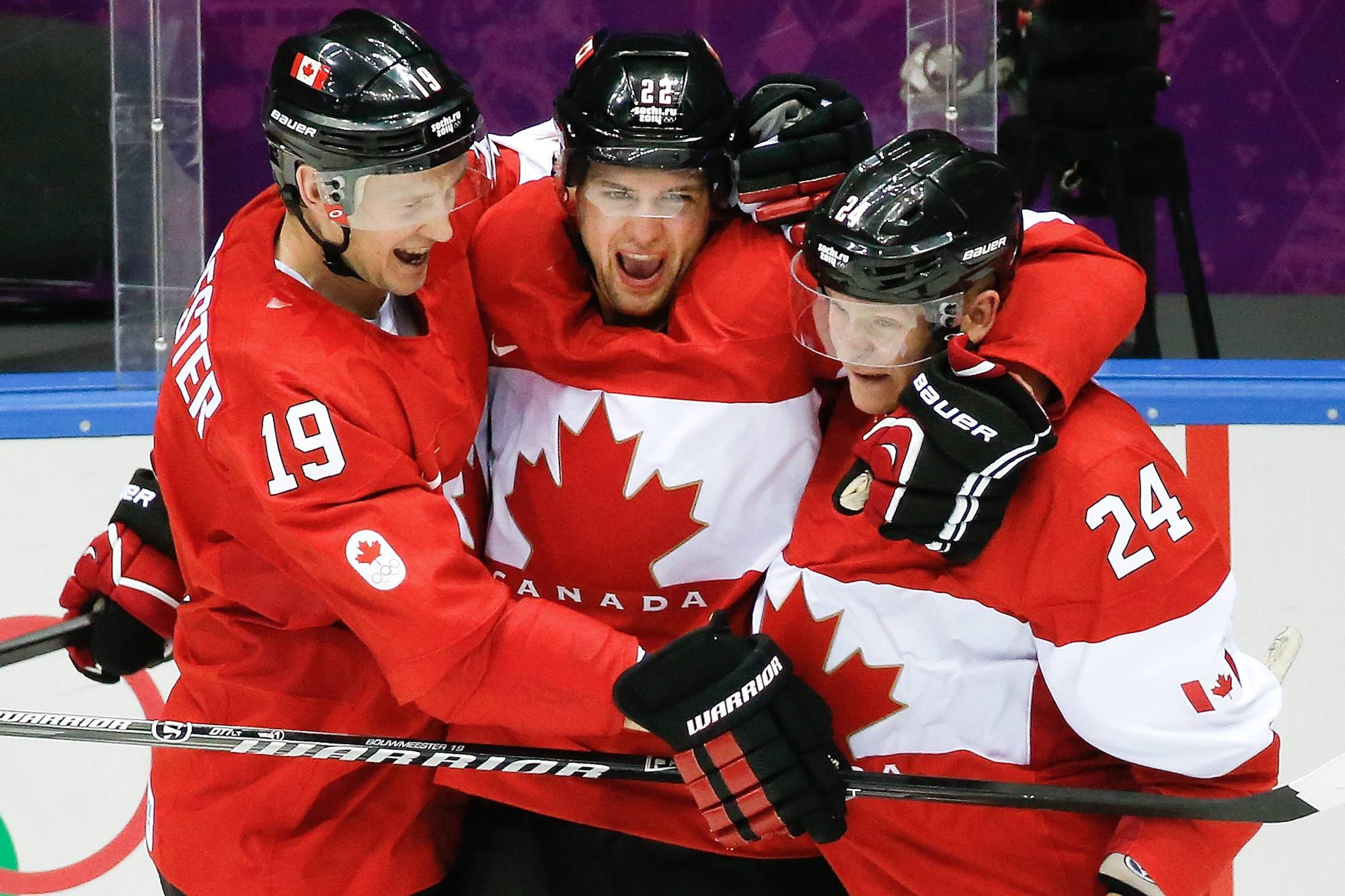 Canada forward Benn Jamie, center, celebrates his goal against the USA with teammates Jay Bouwmeester, left, and Corey Perry, right, during the second period.