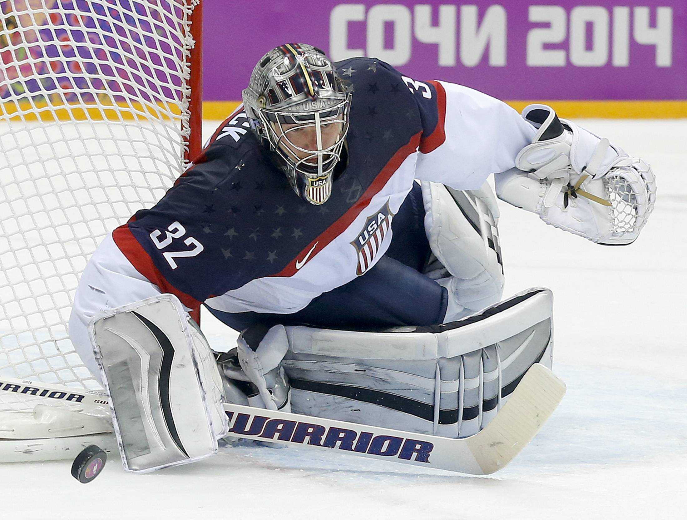 USA goaltender Jonathan Quick pushes off the puck to a teammate during the second period.