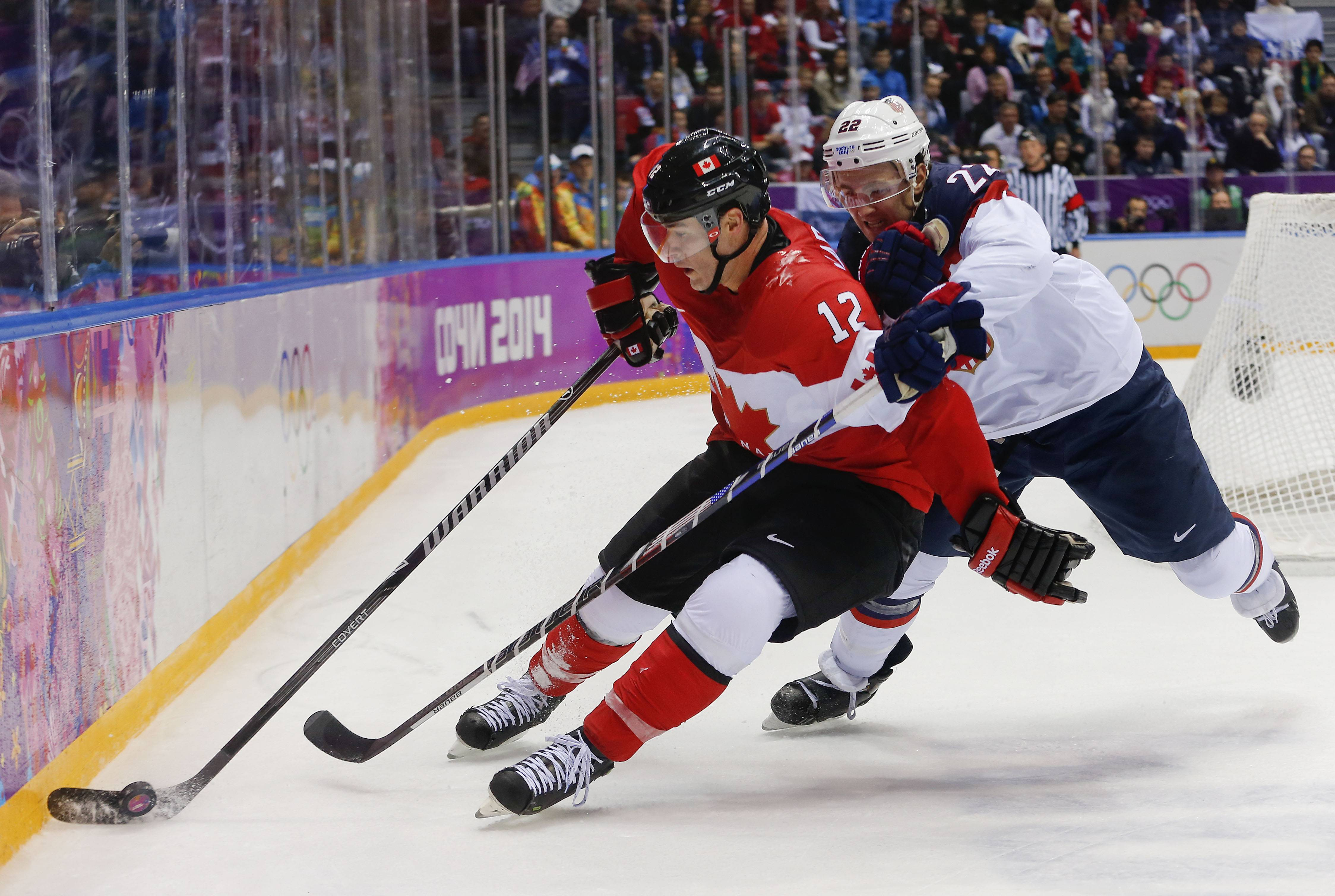 Canada forward Patrick Marleau steals the puck from USA defenseman Kevin Shattenkirk.
