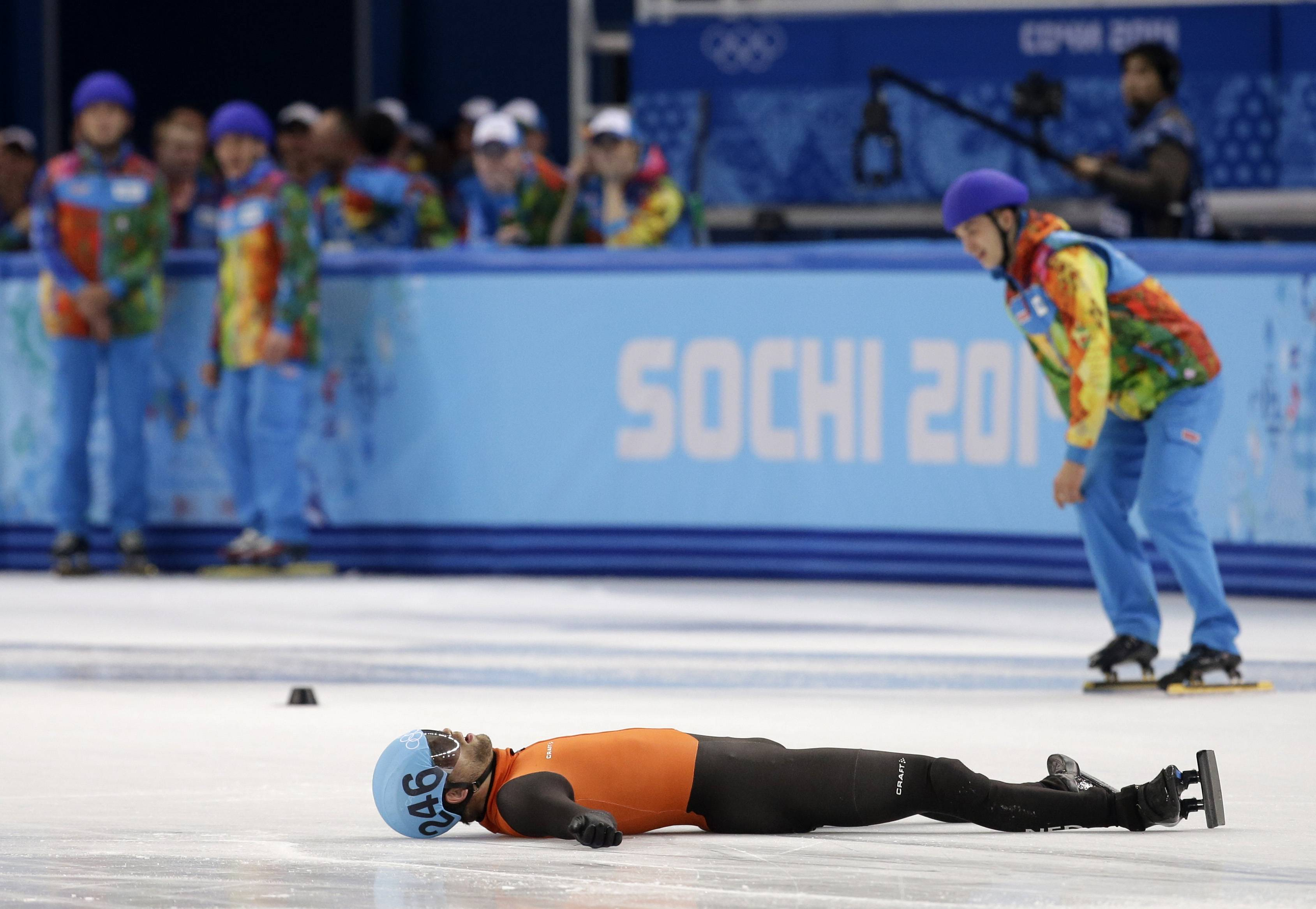 Daan Breewsma of the Netherlands lies on the ice after competing in the men's 5000m short track speedskating relay final.