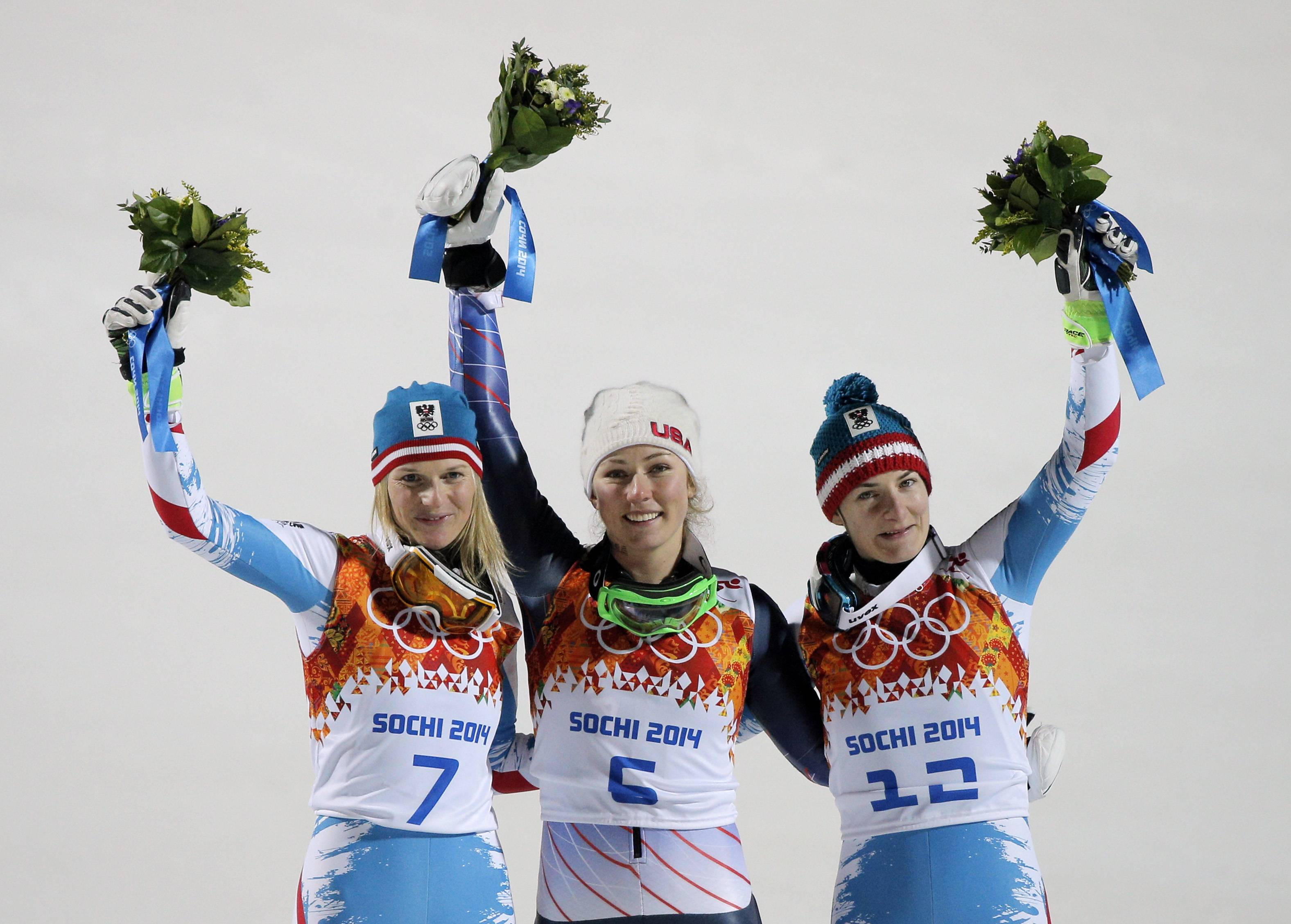 Women's slalom medalists, from left, Austria's Marlies Schild (silver), United States' Mikaela Shiffrin (gold), and Kathrin Zettel (bronze) pose for photographers.