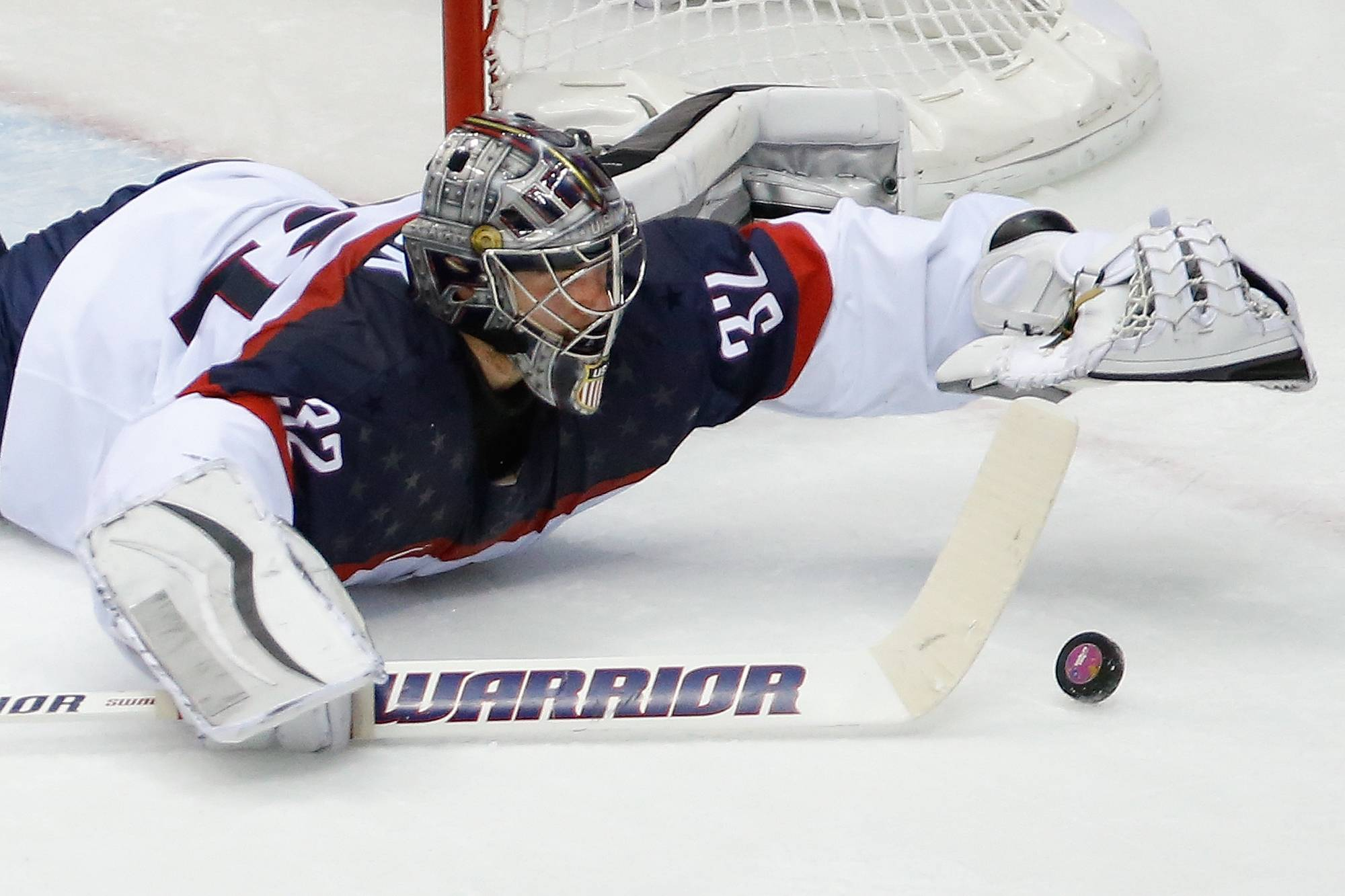 USA goaltender Jonathan Quick dives for the puck during the second period.