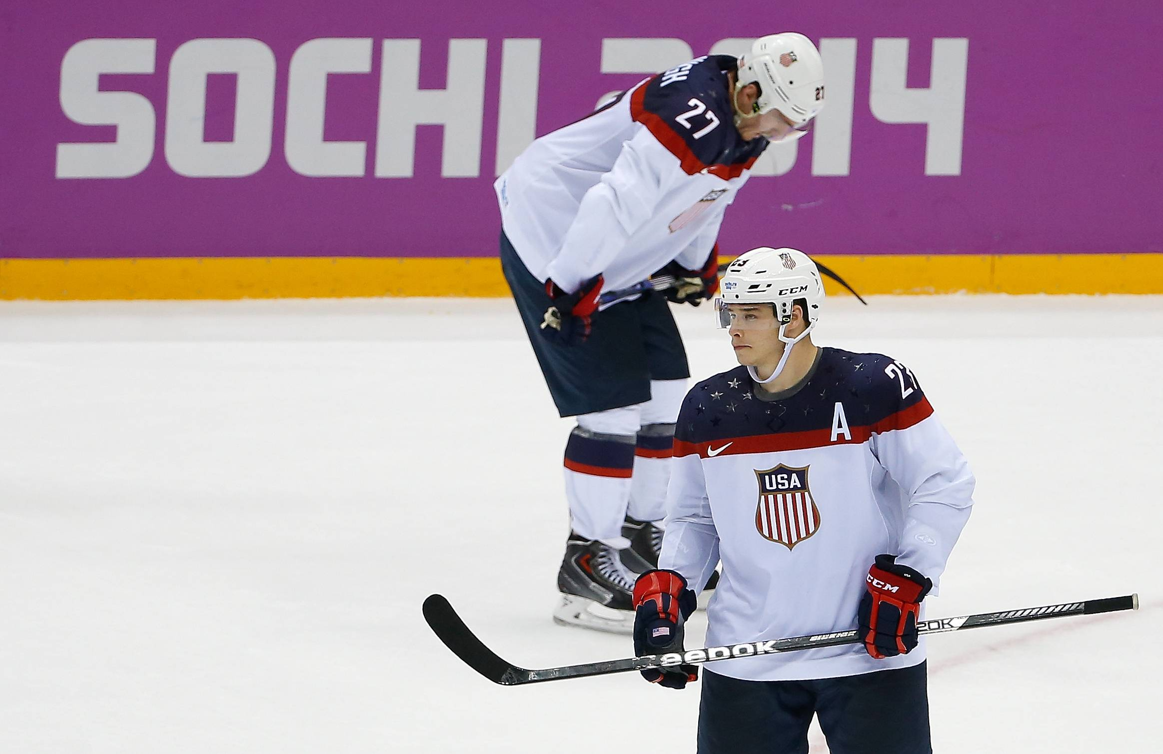 USA forward Dustin Brown (23) and USA defenseman Ryan McDonagh (27) stand on the ice after the 1-0 loss to Canada.