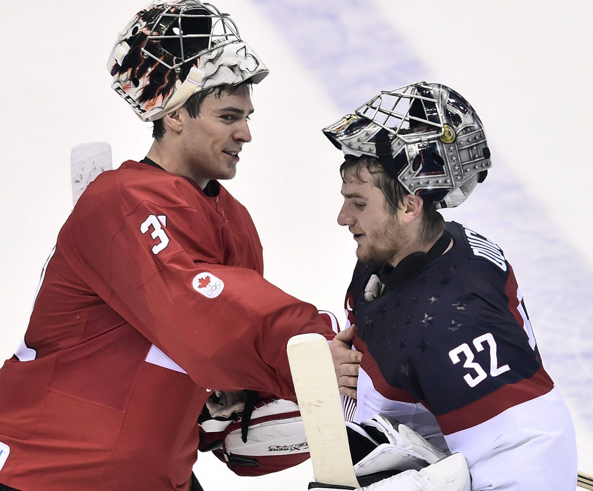 Carey Price of Canada, left, meets goaltender Jonathan Quick of the United States, after Canada beat the USA 1-0 in a men's semifinal ice hockey game.