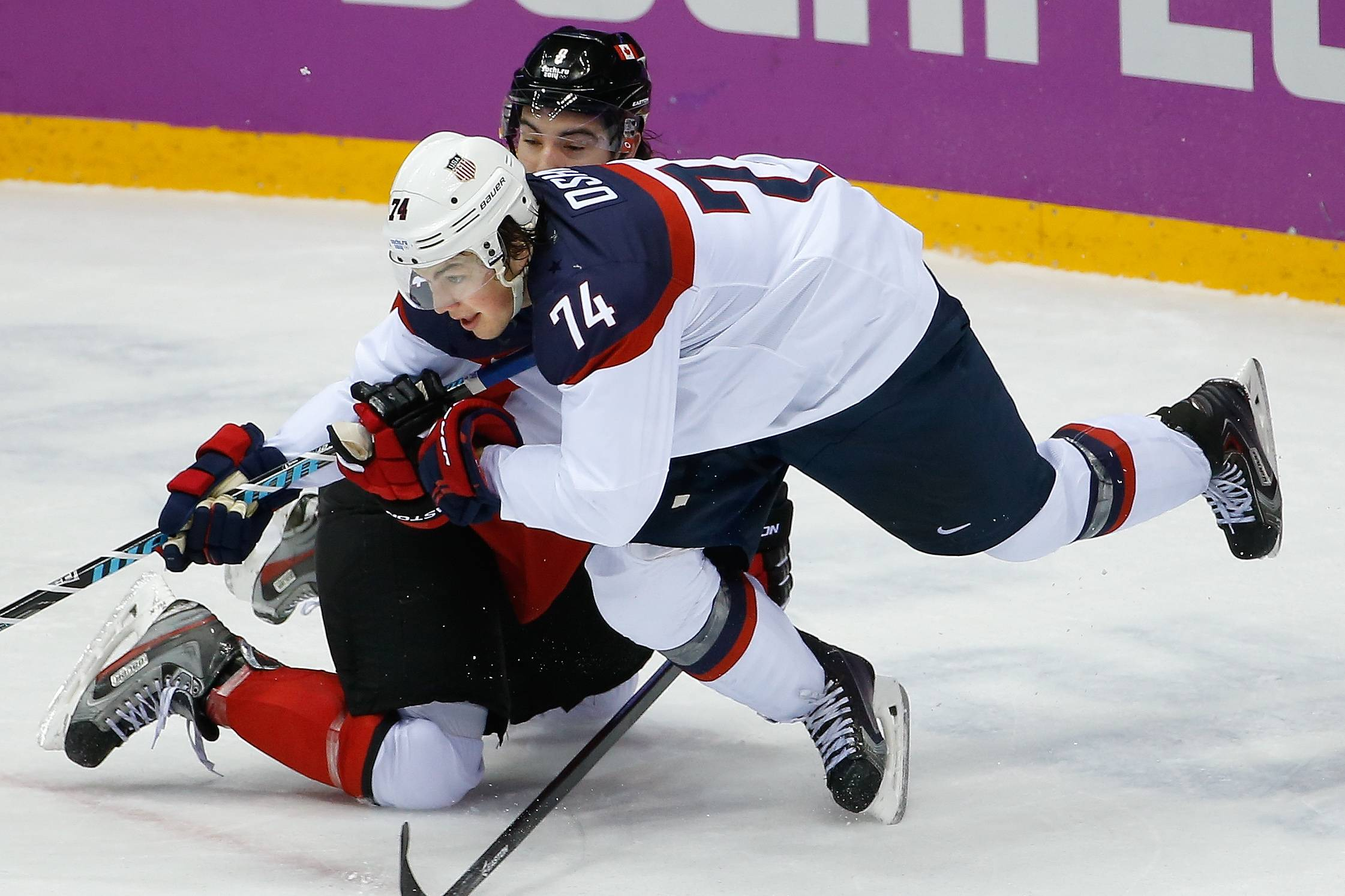 Canada defenseman Drew Doughty and USA forward T.J. Oshie collide on the ice during the second period.