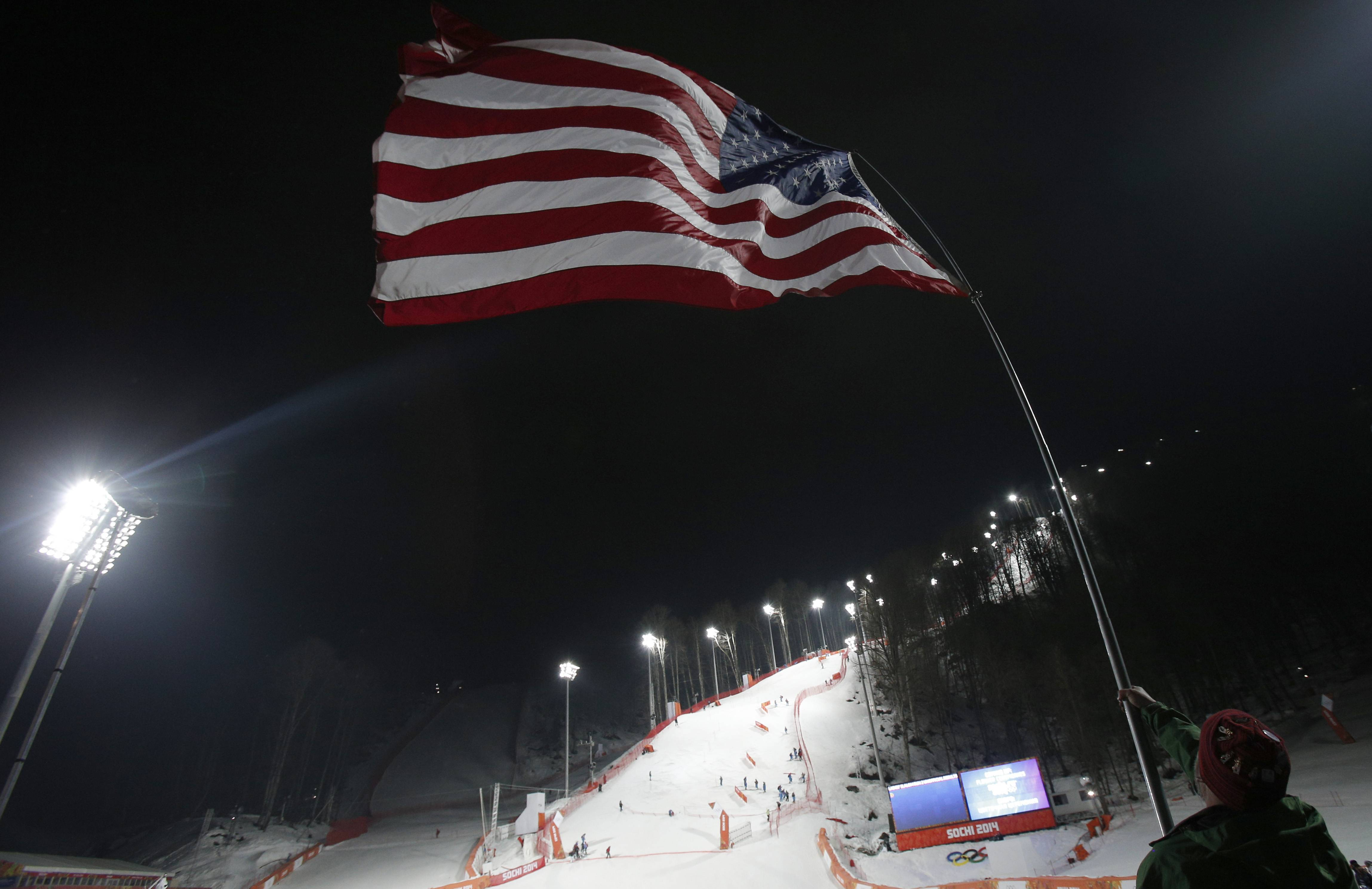 A fan waves the U.S. flag after United States' Mikaela Shiffrin won the gold medal in the women's slalom.
