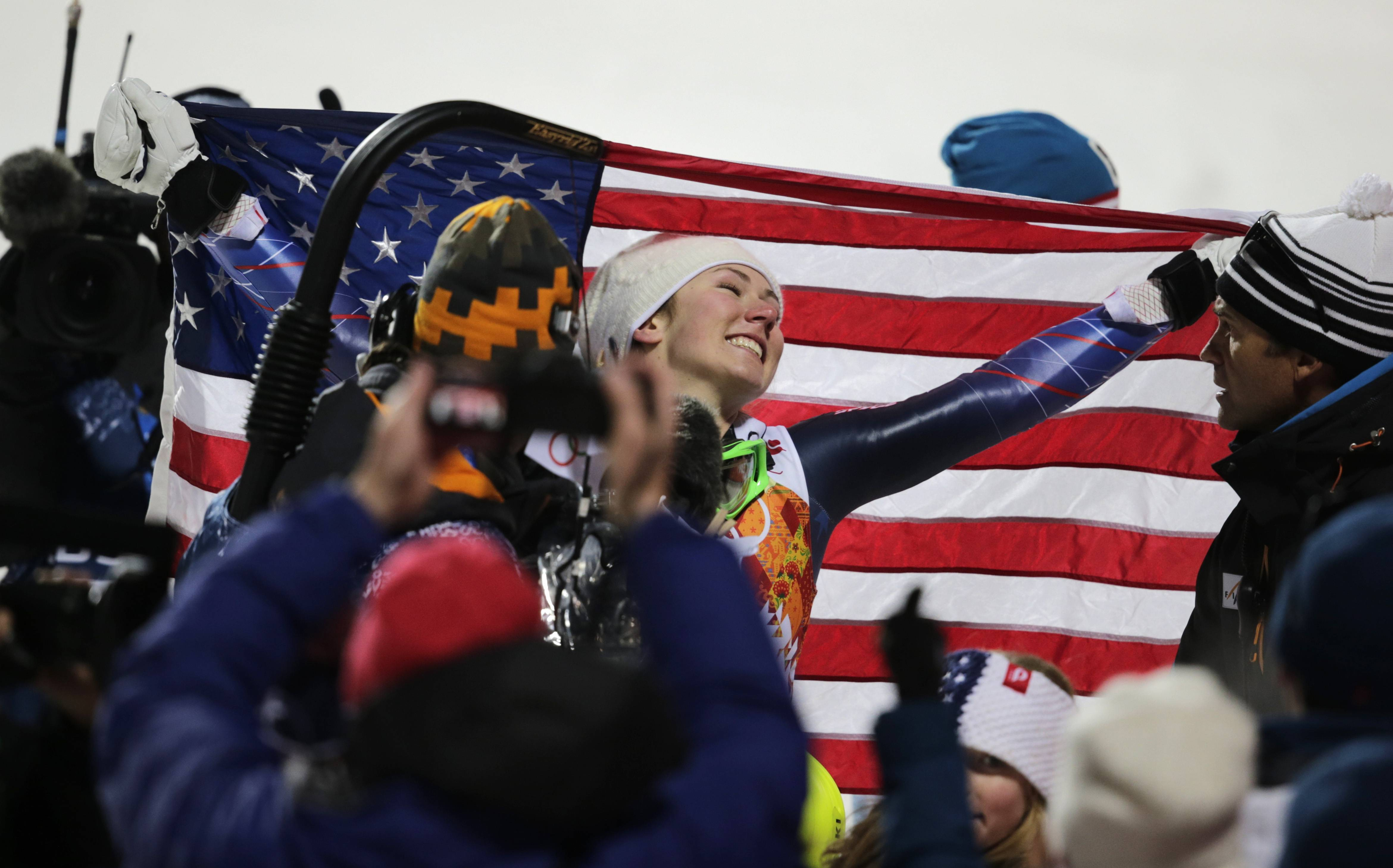 United States' Mikaela Shiffrin poses with the American flag after winning the gold medal in the women's slalom.