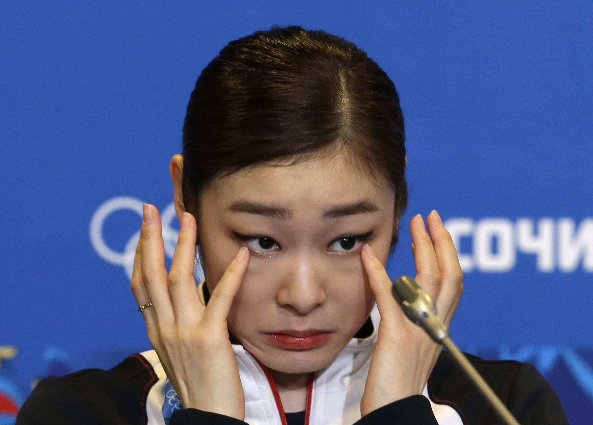Yuna Kim of South Korea wipes her face as she attends a news conference following the women's free skate figure skating finals at the Iceberg Skating Palace during the 2014 Winter Olympics, Thursday, Feb. 20, 2014, in Sochi, Russia.