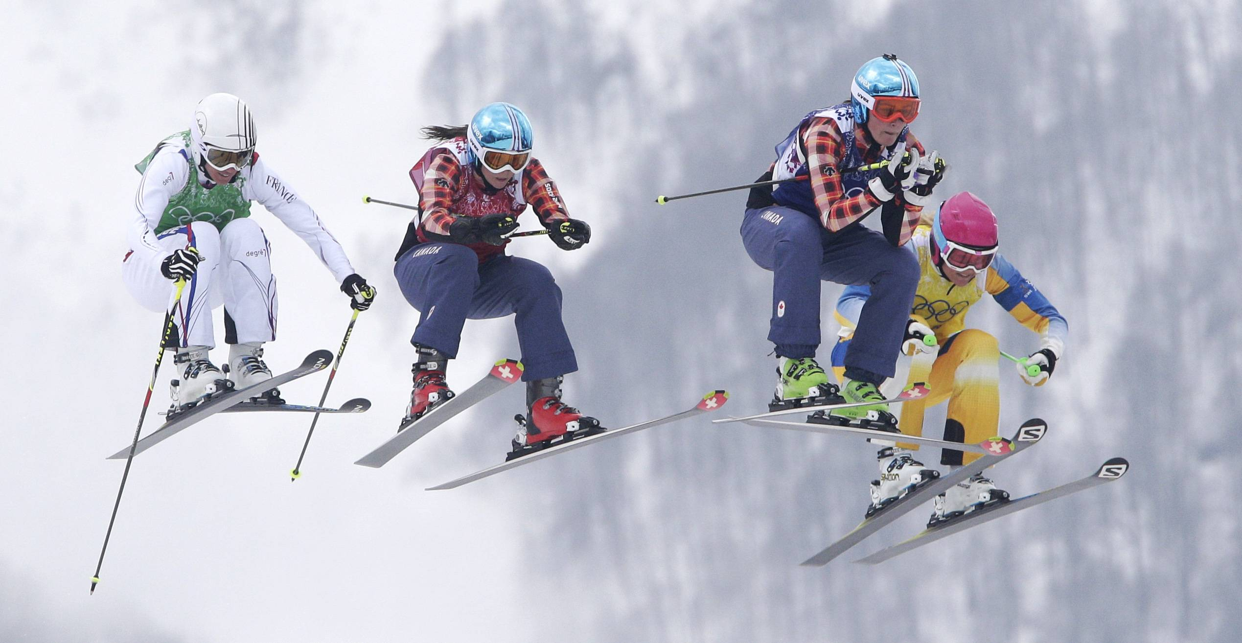 France's Ophelie David, from left, Canada's Kelsey Serwa, Canada's Marielle Thompson and Sweden's Anna Holmlund compete Friday during their ski cross final at the 2014 Winter Olympics in Krasnaya Polyana, Russia.