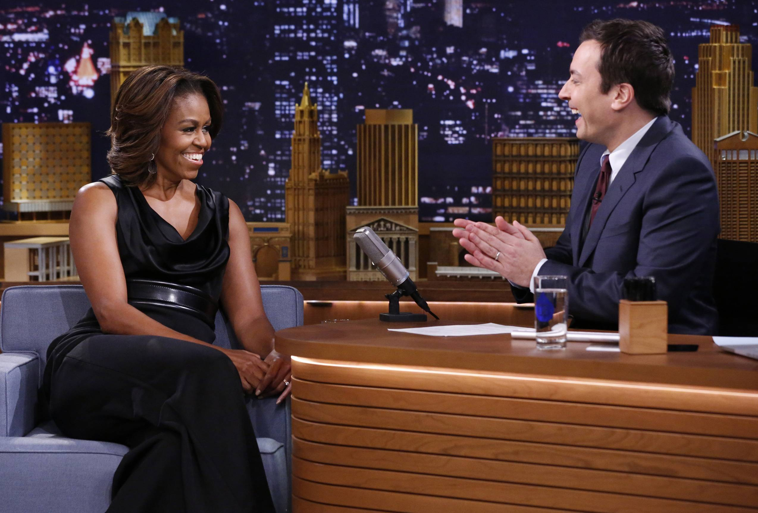 "Jimmy Fallon applauds first lady Michelle Obama Thursday on the set of ""The Tonight Show Starring Jimmy Fallon,"" in New York."