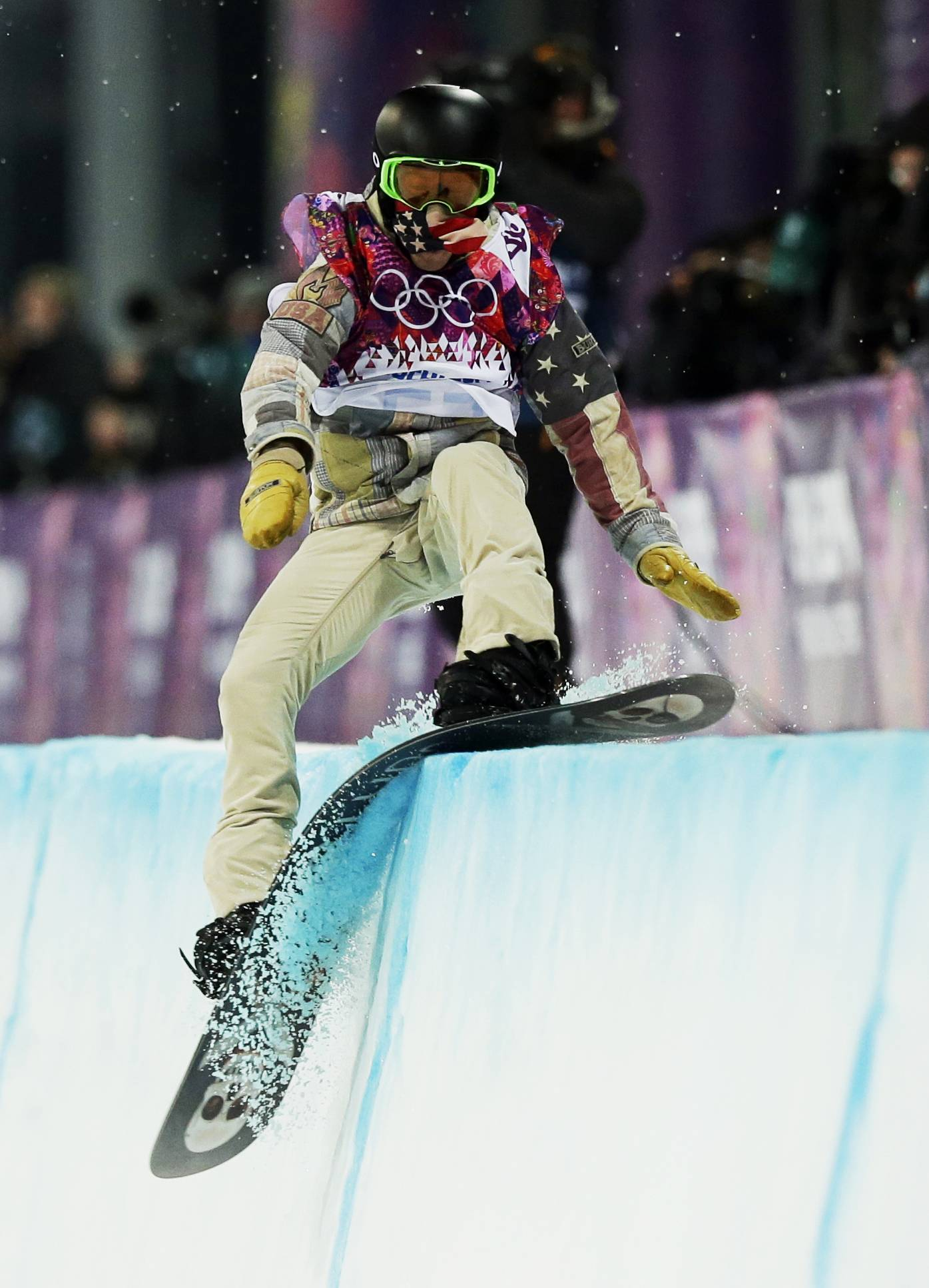 Shaun White, of the United States, hits the edge of the half pipe during the men's snowboard halfpipe final at the Rosa Khutor Extreme Park, at the 2014 Winter Olympics, Tuesday, Feb. 11, 2014, in Krasnaya Polyana, Russia.