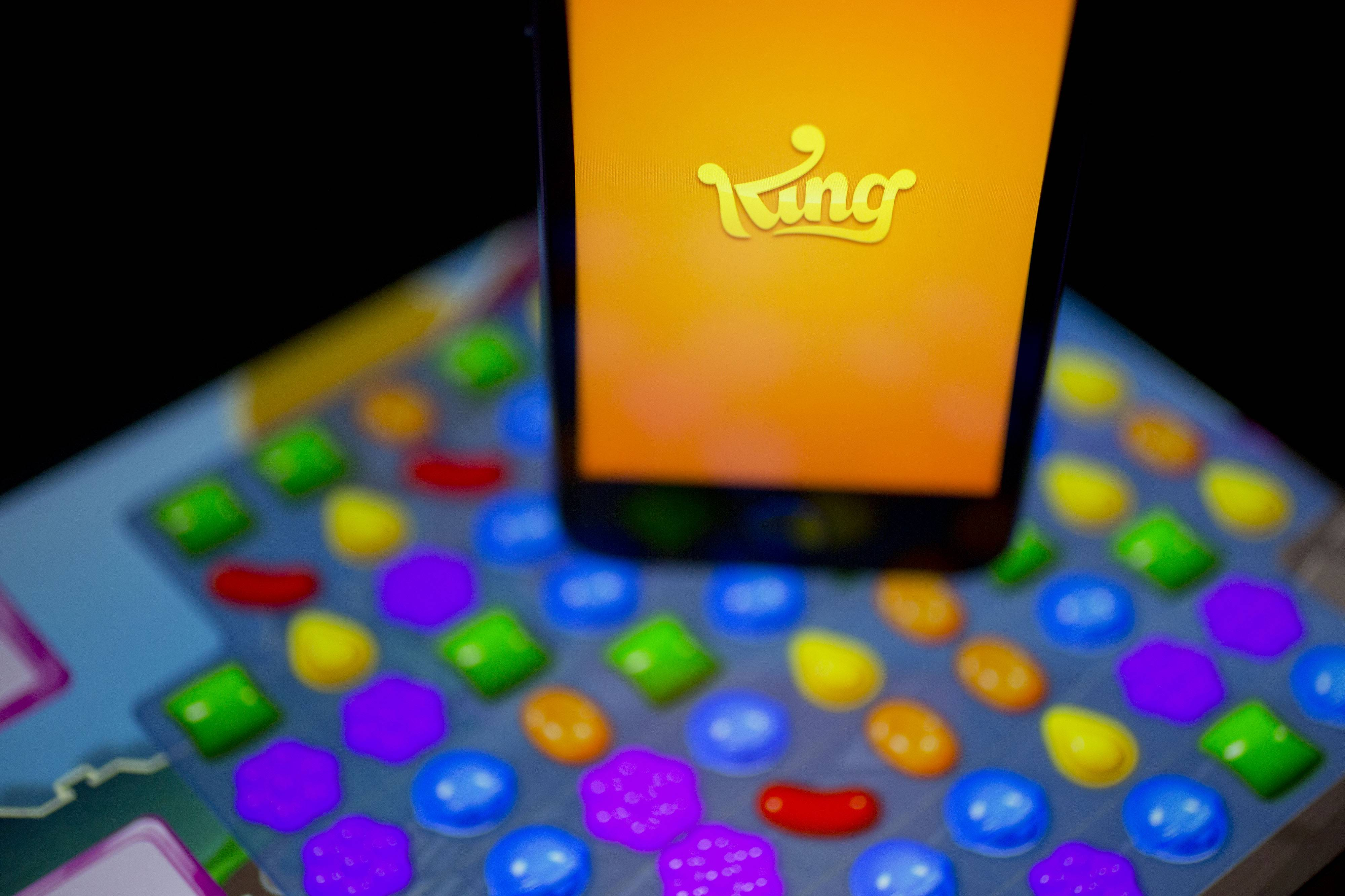 "The King Digital Entertainment Plc logo and ""Candy Crush Saga"" game are displayed on an Apple Inc. iPhone 5s and iPad Air in this arranged photograph in Washington, D.C., U.S., on Tuesday, Feb. 18, 2014. King Digital Entertainment Plc, the maker of popular smartphone games including ""Candy Crush Saga"" and ""Pet Rescue Saga,"" is beginning an adventure of its own on a path to becoming a public company."