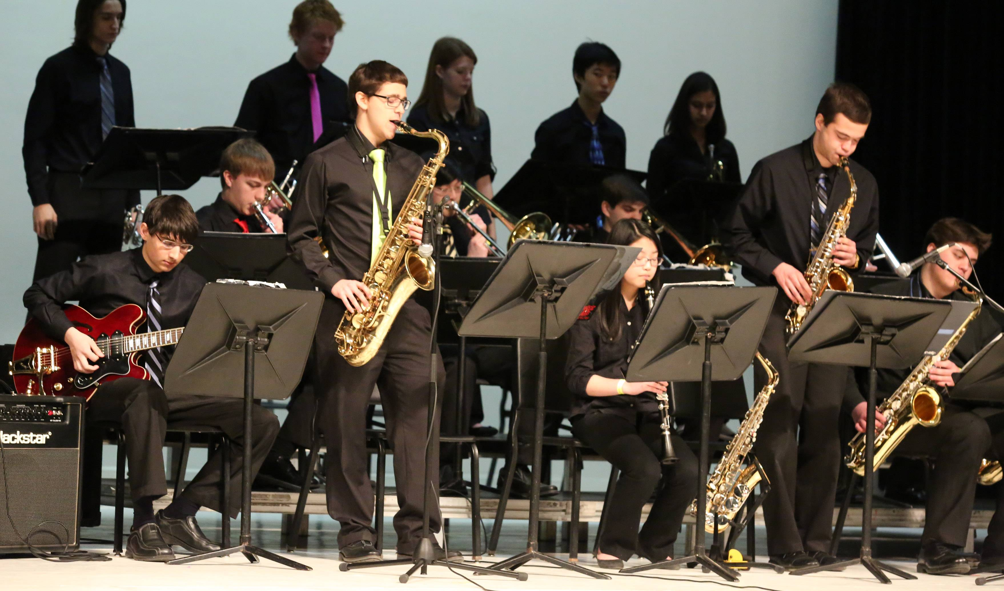 Isaiah Sanderman, left, and Ryan Cajandig, both standing, playing the saxophone in Fremd High School's jazz ensemble one at the 29th annual Jazz in the Meadows program on Saturday in the theater at Rolling Meadows High School.