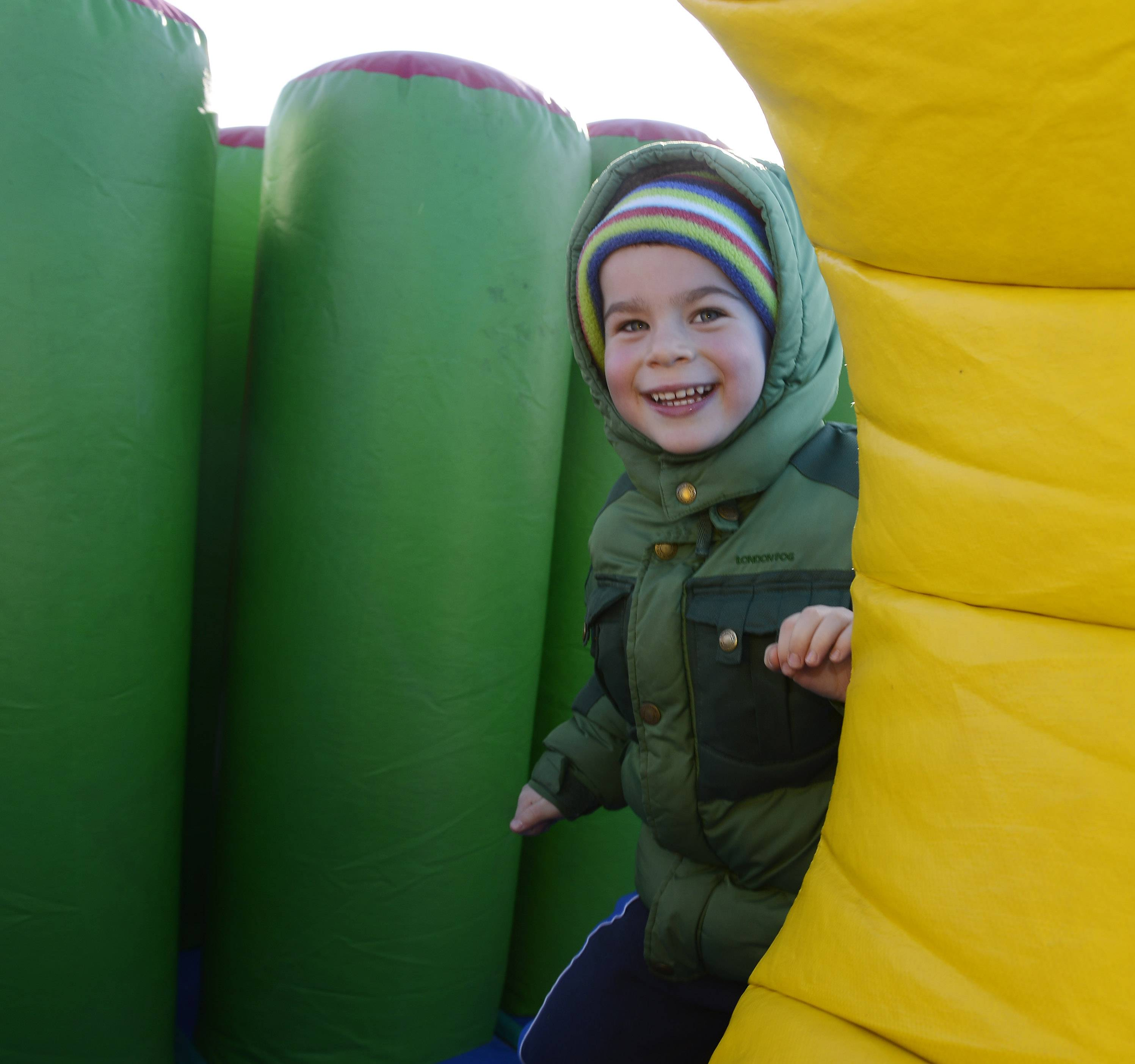 JOE LEWNARD/jlewnard@dailyherald.com Danny Lawitz, 4, of Wauconda has fun on the inflatable play set Saturday during the Winter Wonderland Carnival at Community Park in Hawthorn Woods.