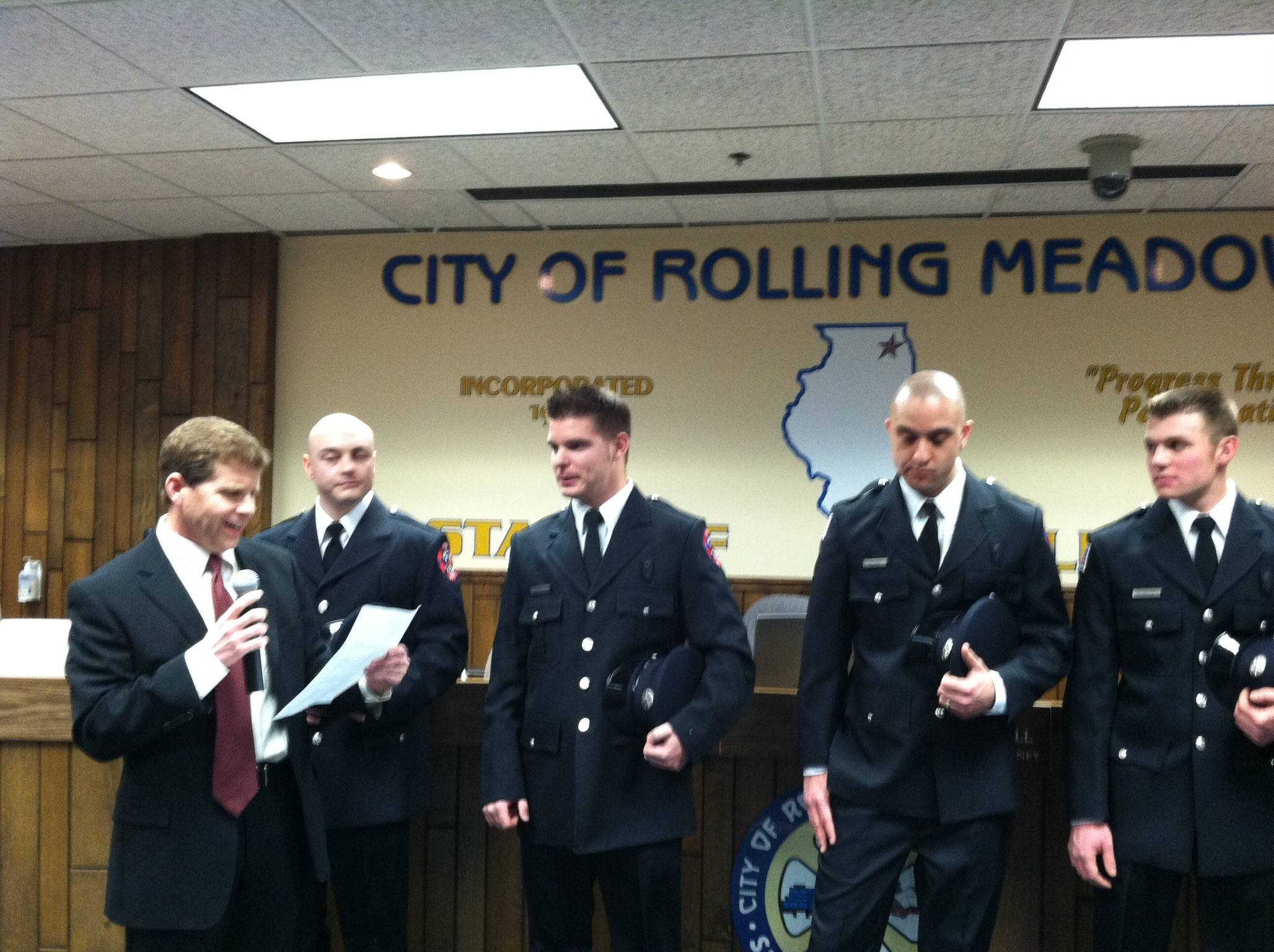 Rolling Meadows Mayor Rooney introduces new firefighter/ paramedics at a recent city council meeting. They are, from left: Paul Davis, Matt Cappelen, Jason Wenzel and John Loesch Jr.
