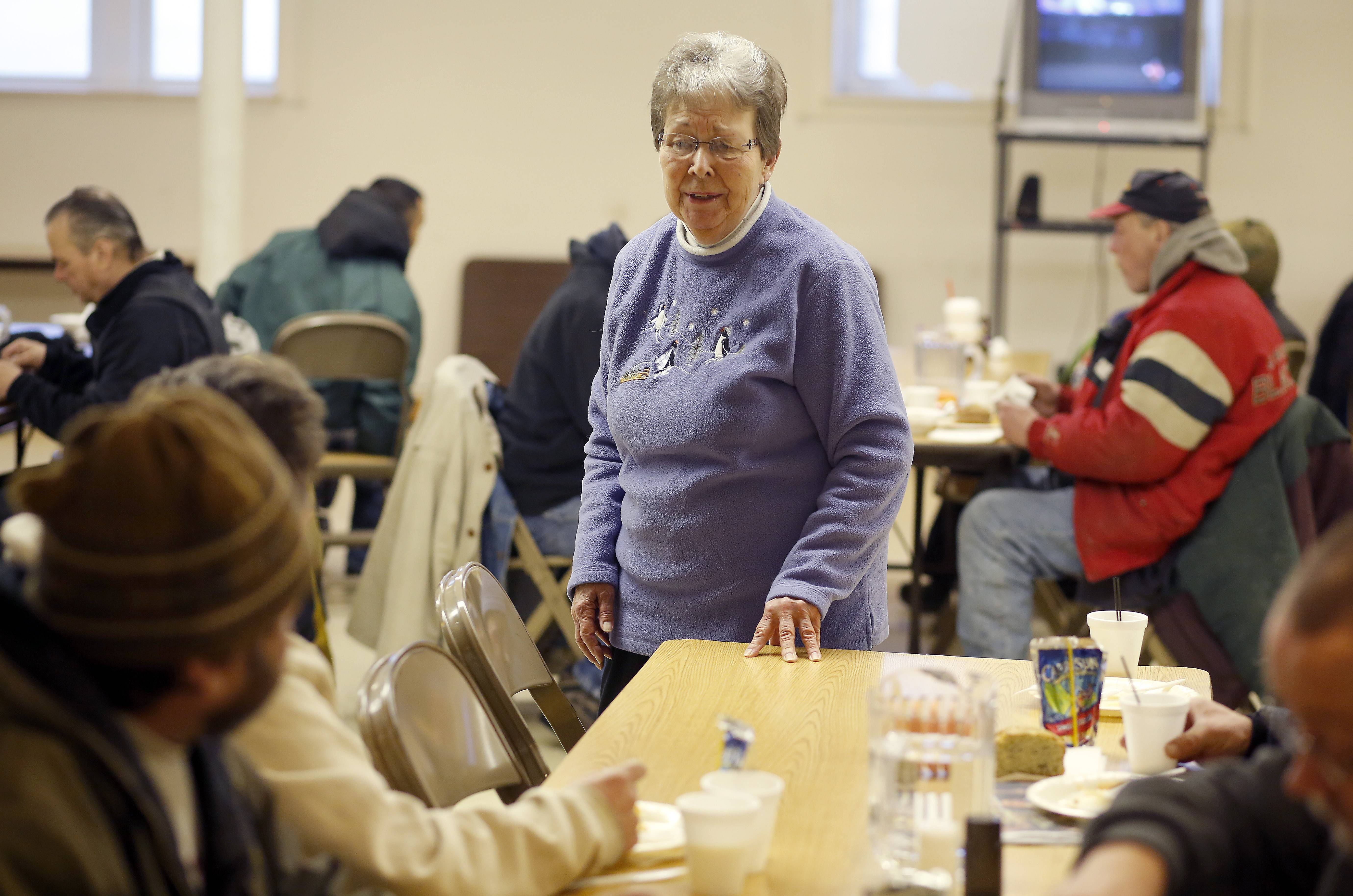 Nancy Merlak checks with some of the guests during a recent breakfast. Volunteers from all over serve a hot breakfast to the homeless from 6:30 to 8 a.m. Monday through Friday at Vineyard Church, Elgin.