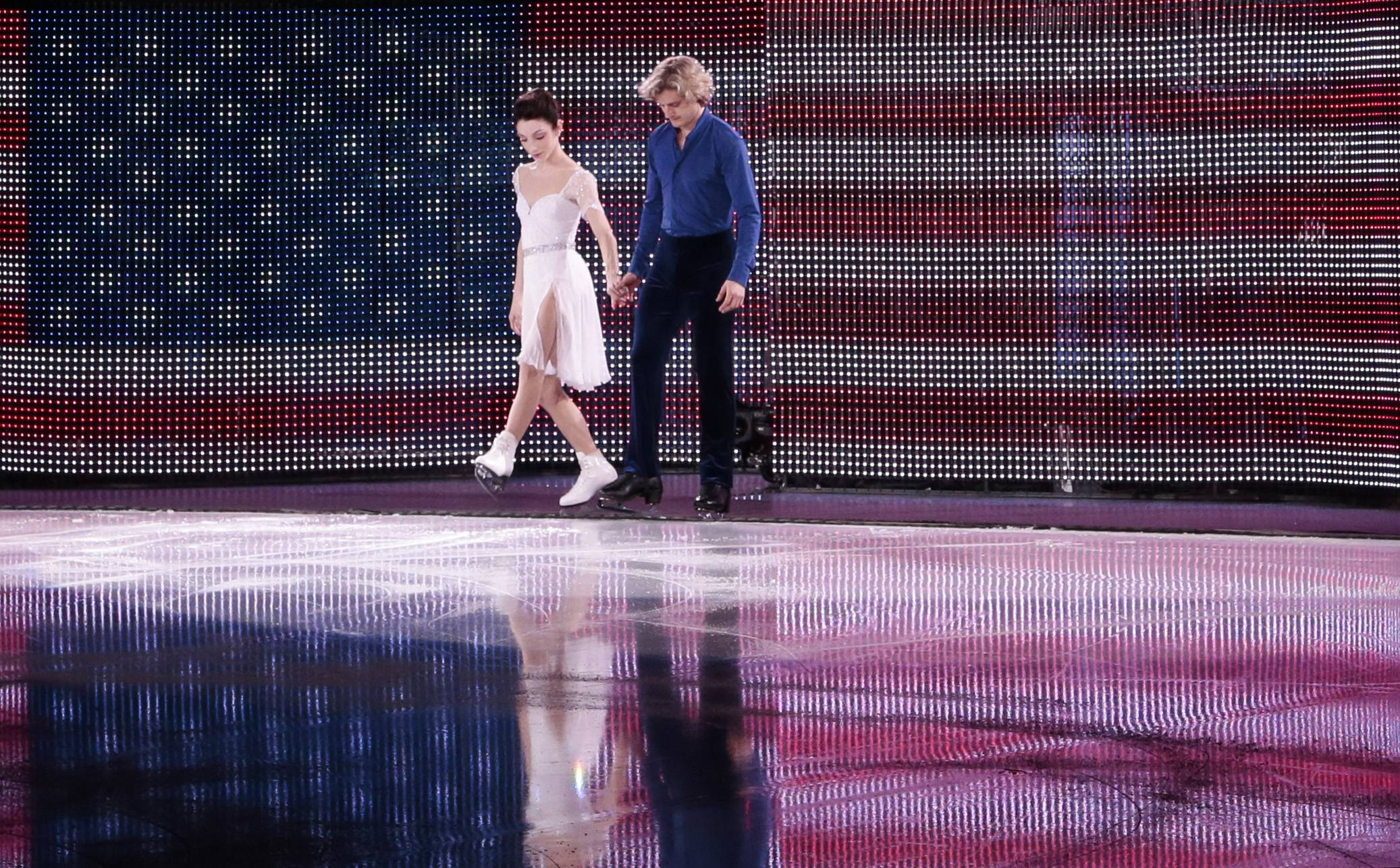 Meryl Davis and Charlie White of the United States step onto the ice before performing in the figure skating exhibition gala at the Iceberg Skating Palace during the 2014 Winter Olympics, Saturday, Feb. 22, 2014, in Sochi, Russia.