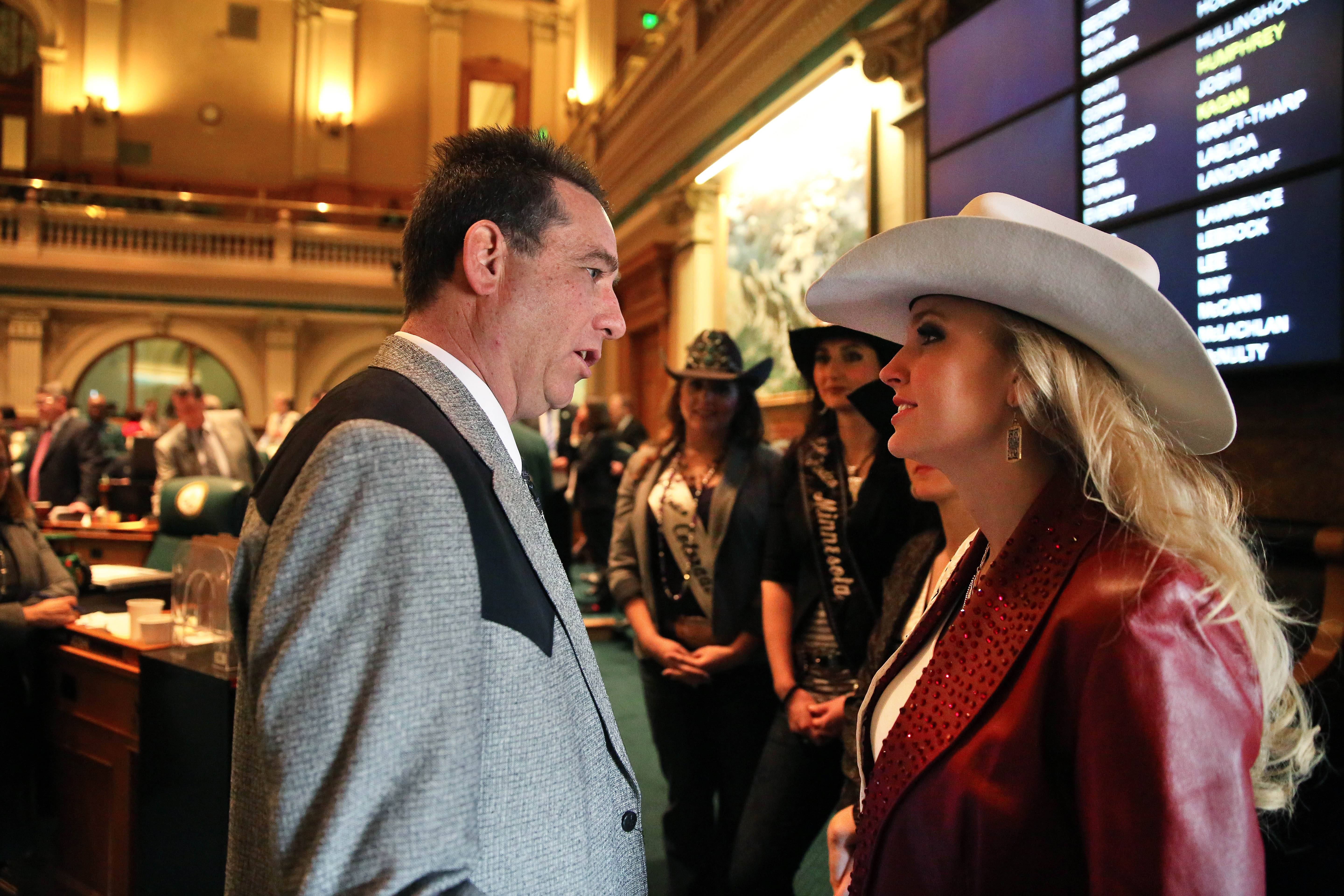 Republican Colorado state representative Jerry Sonnenberg talks with Miss Rodeo America Paige Nicholson, inside the chambers of the Colorado State Legislature, at the Capitol, in Denver. Nicholson was in town for the National Western Stock Show. Sonnenberg, a rancher who's the only farmer in the Colorado House, plans to push a radical idea this session: give each of his state's 64 counties one House seat apiece instead of electing representatives from districts with equal populations.
