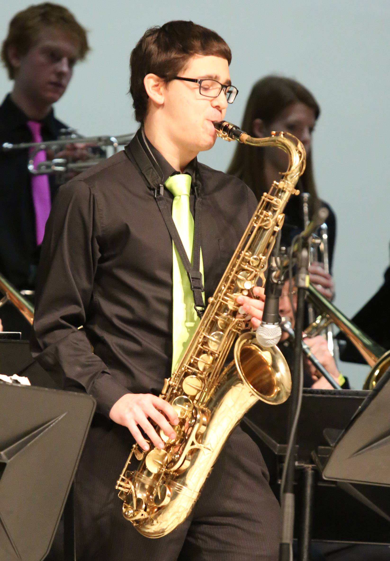 Isaiah Sanderman playing the saxophone in Fremd High School's jazz ensemble one at the 29th annual Jazz in the Meadows program on Saturday at Rolling Meadows High School.