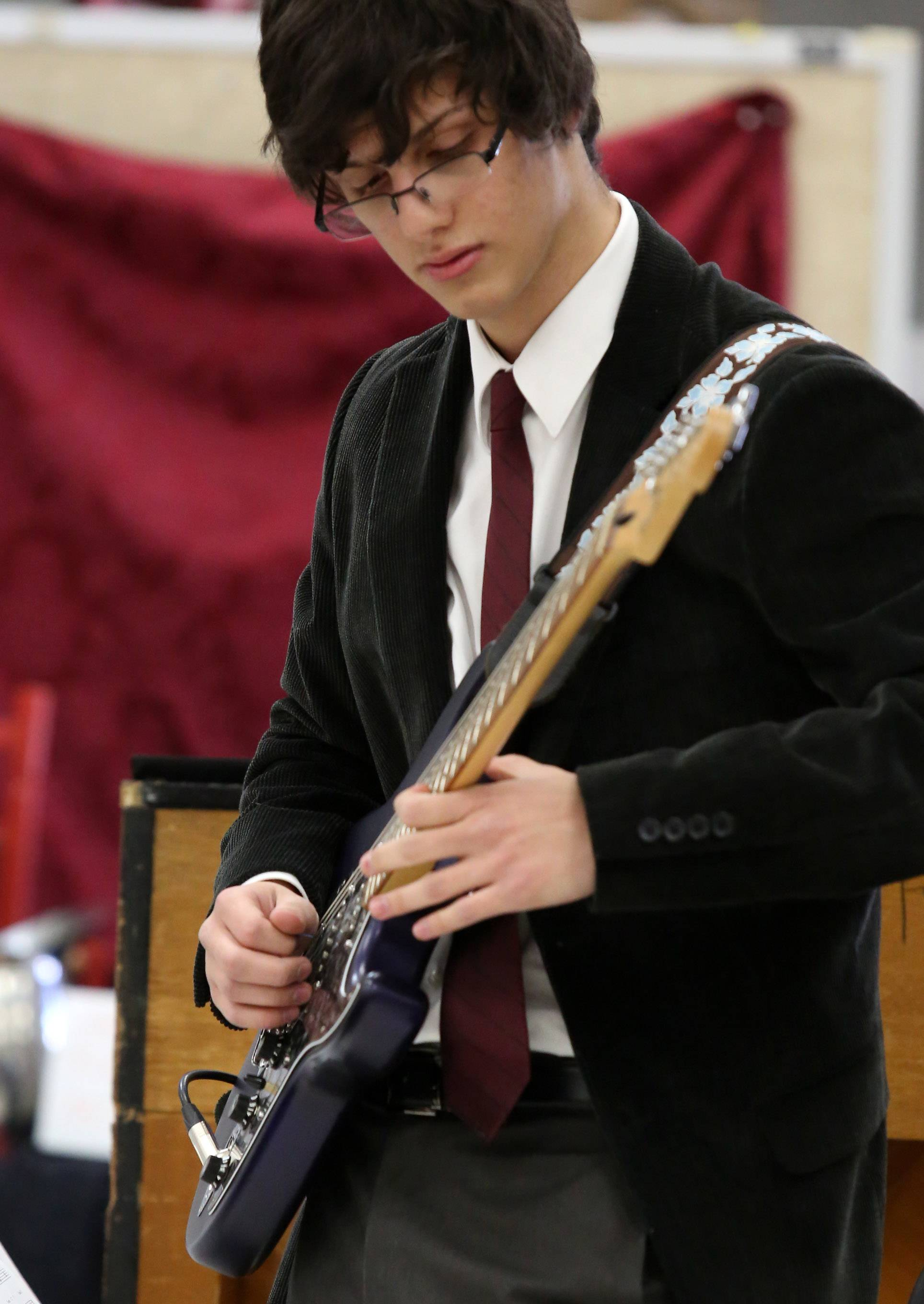 Prussian Gueorguiev plays the guitar in Warren High School's jazz combo directed by Chris Madsen, performs at the 29th annual Jazz in the Meadows program on Saturday in the art room at Rolling Meadows High School.