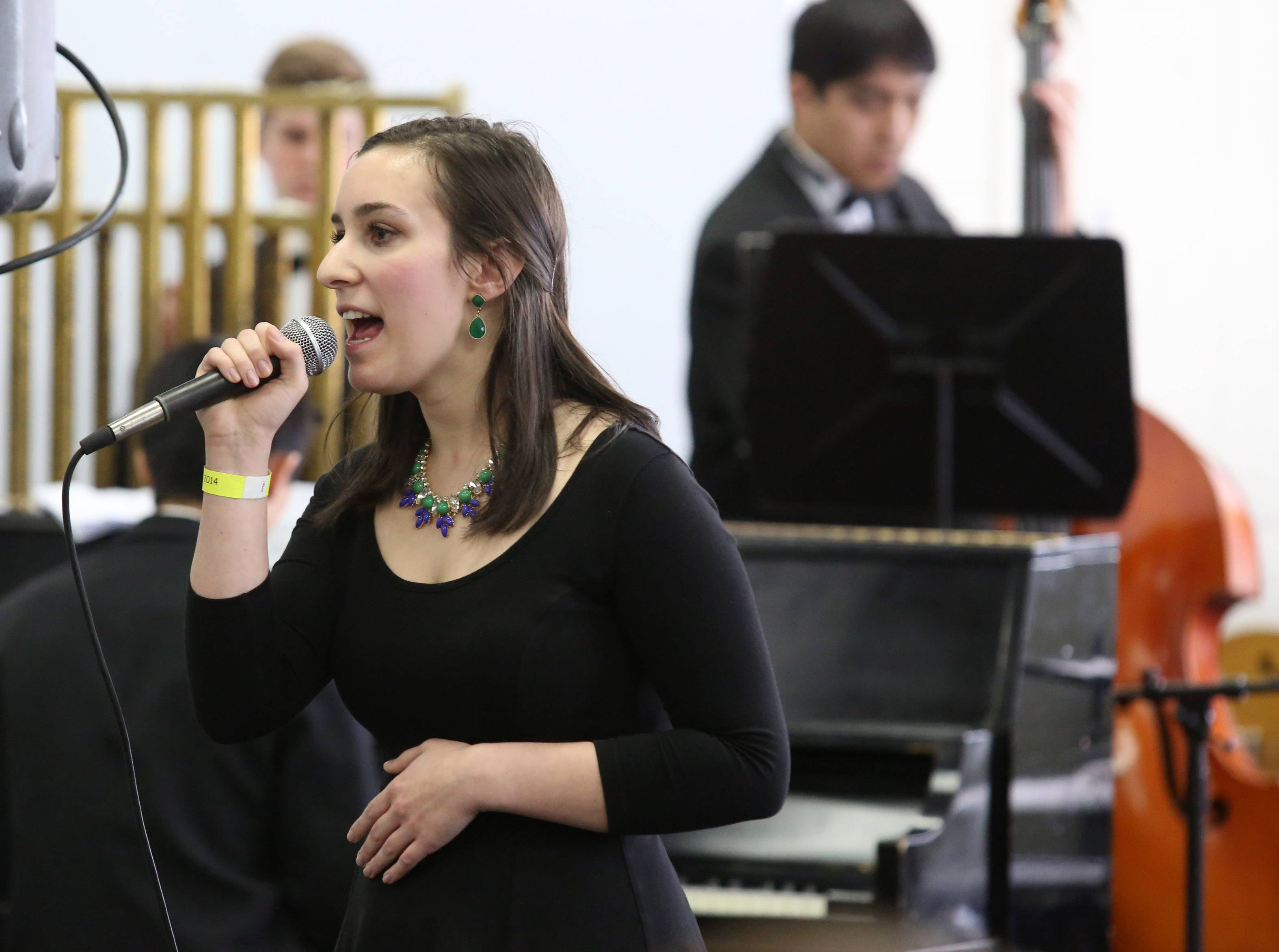 Kaitlyn Edicola sings with Carmel High School's jazz band, directed by David Wiebers, at the 29th annual Jazz in the Meadows program on Saturday in the library at Rolling Meadows High School.
