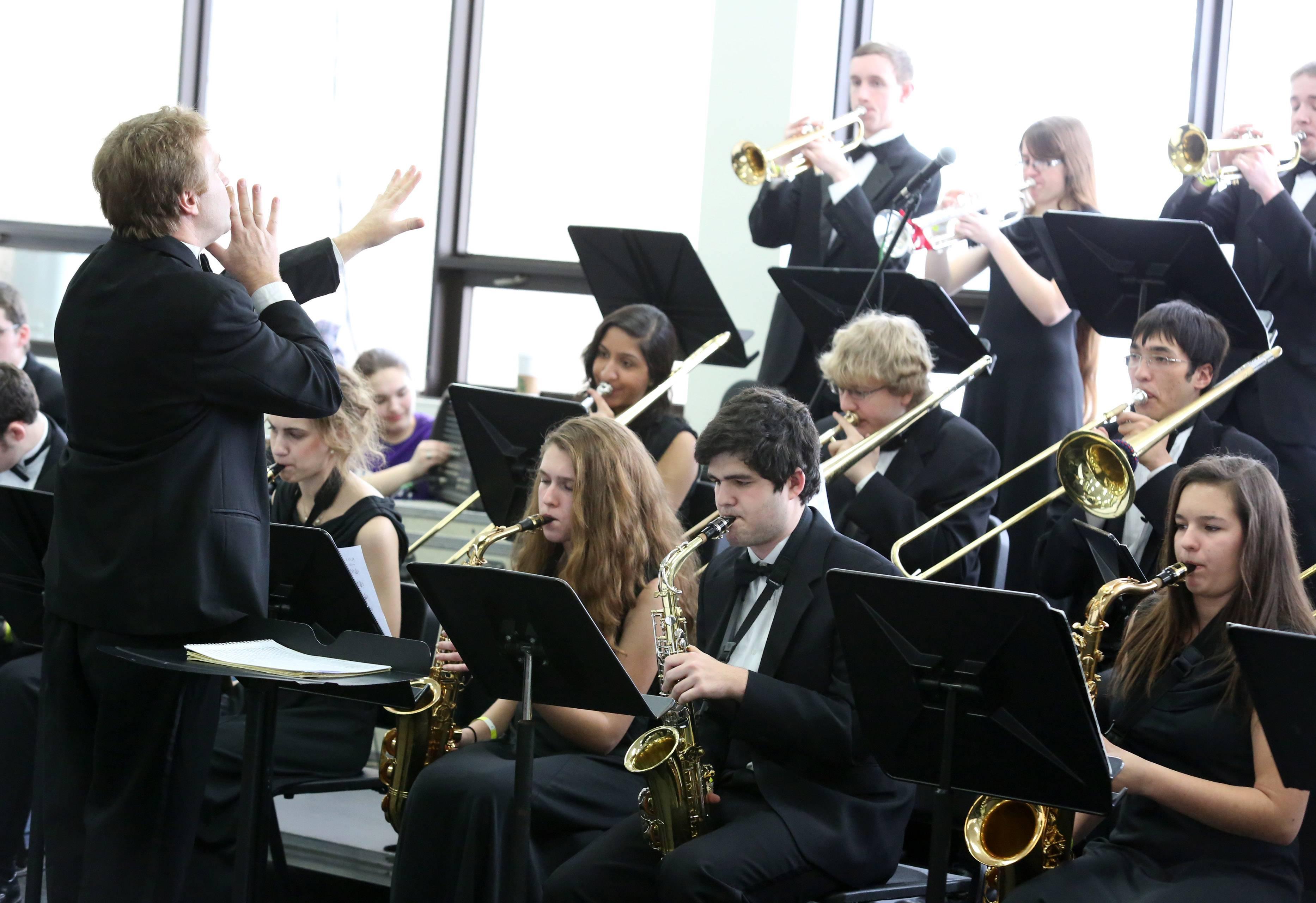 Carmel High School's jazz band, directed by David Wiebers, performs at the 29th annual Jazz in the Meadows program on Saturday in the library at Rolling Meadows High School.
