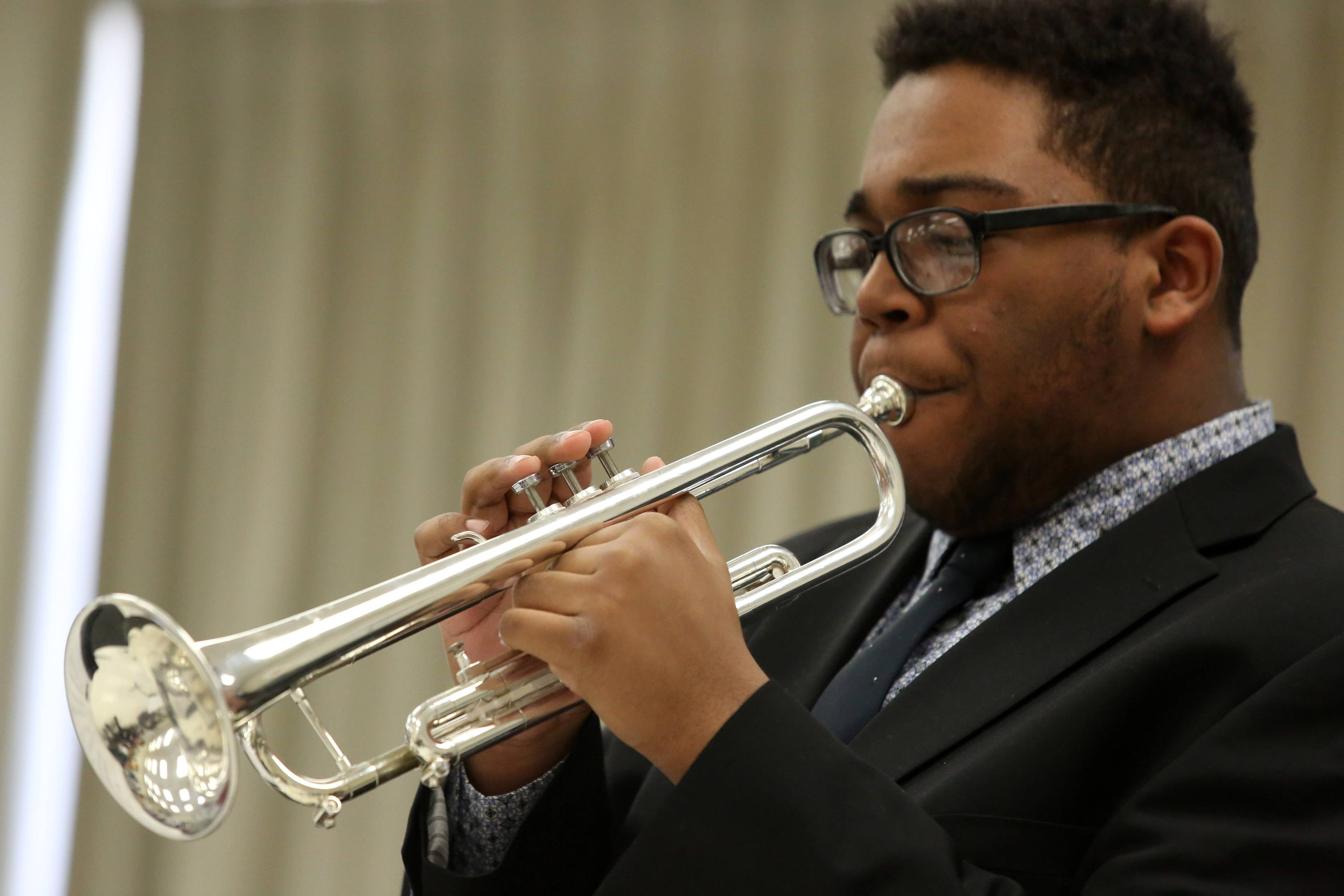 Nick Alleyne plays the trumpet in Warren High School's jazz combo, directed by Chris Madsen, at the 29th annual Jazz in the Meadows program on Saturday in the art room at Rolling Meadows High School.