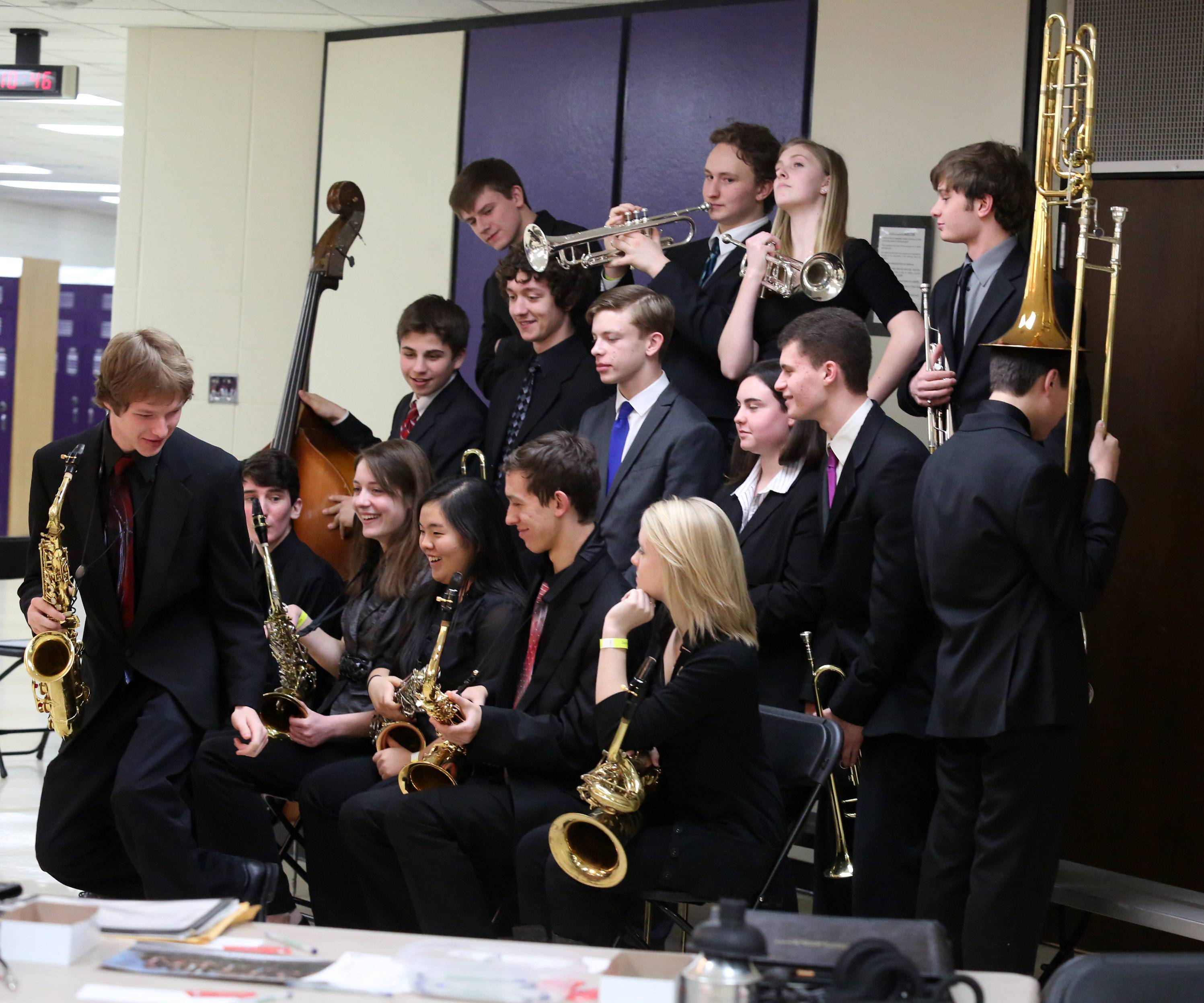 Schaumburg High School's jazz ensemble one makes a funny pose while a photographer takes their picture at the 29th annual Jazz in the Meadows program on Saturday in the theater at Rolling Meadows High School.