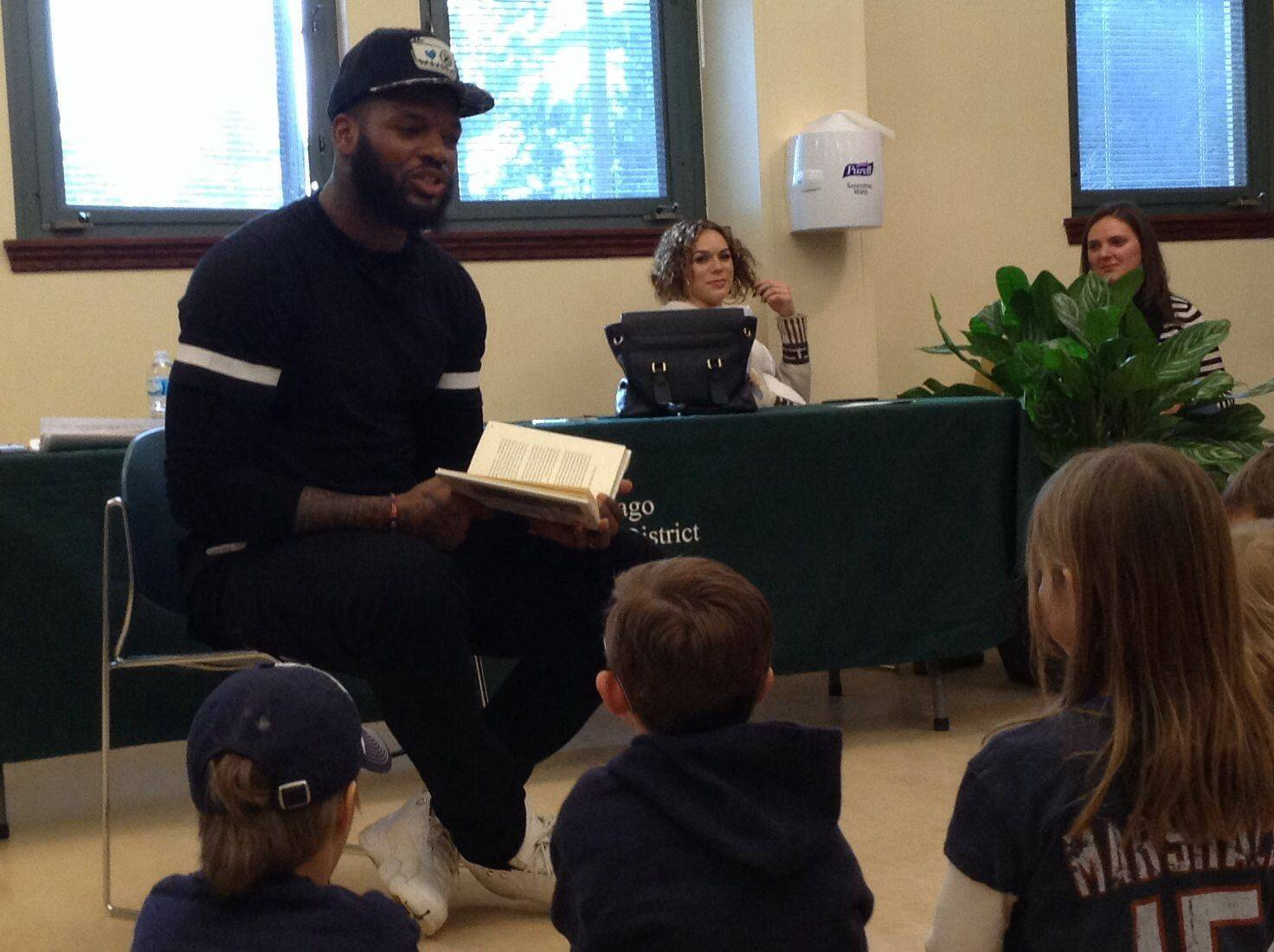 "Martellus Bennett, a tight end with the Chicago Bears, reads to children at the West Chicago Public Library as part of the library's ""Read to Succeed"" program that challenged kids to read eight books between Jan. 4 and Feb. 17."